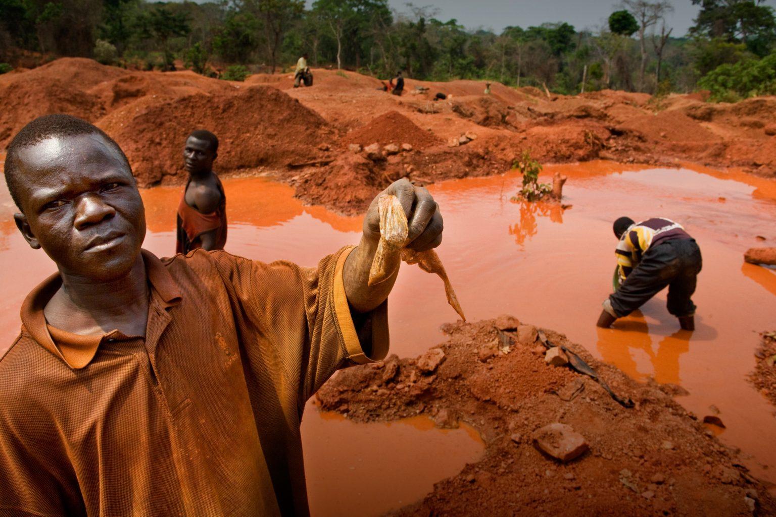 Miner with coltan. Katanga, Carriére Kisengo, Democratic Republic of the Congo, 2008