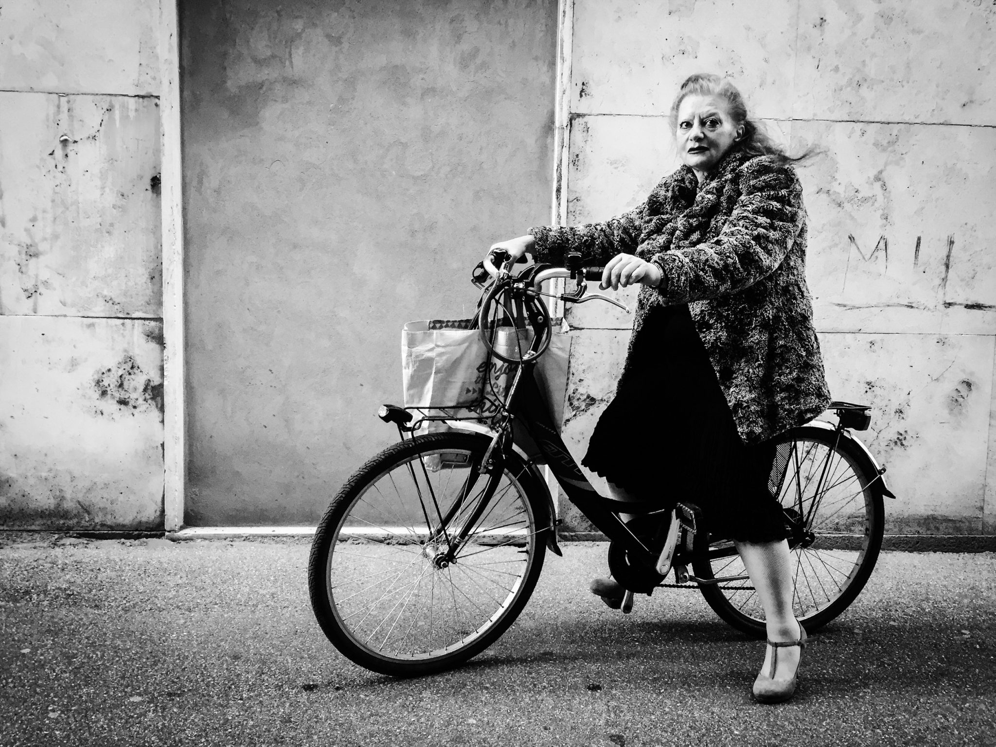 Lady just outside the church right after the service. Rovigo, 2017