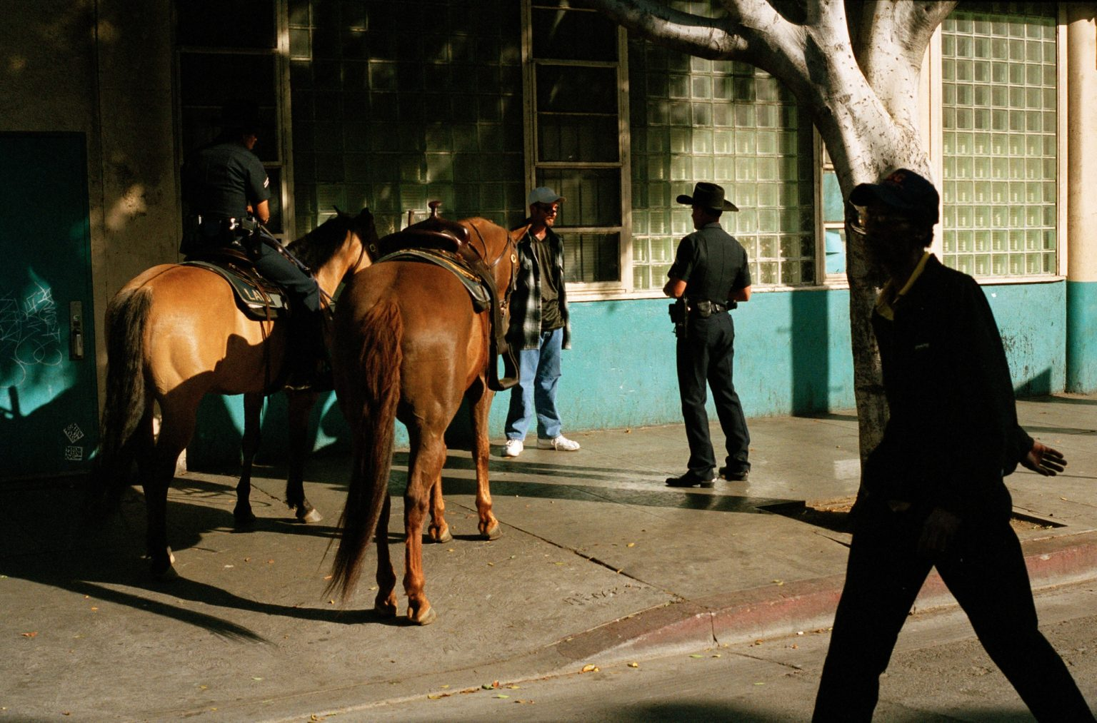 Suspect of drug possession being searched by LAPD, San Pedro street. Skid Row, Los Angeles, United States 2004-2005