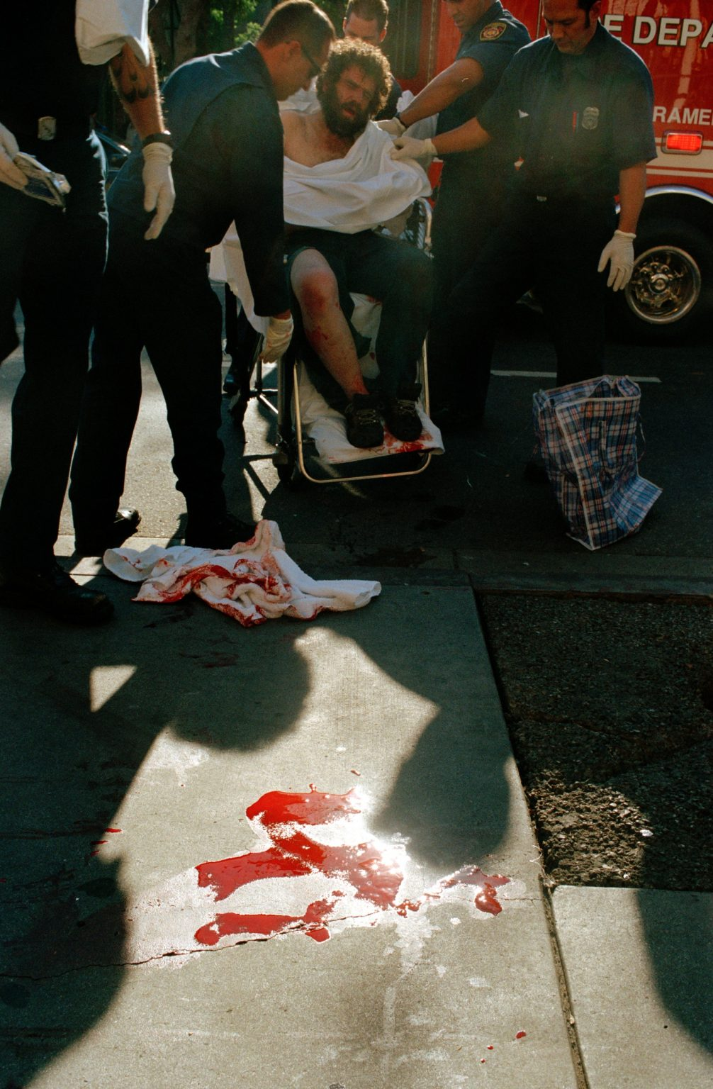 Man stubbed on the street, 5th street. He was then taken to hospital but died due to a fatal wound in his lung. Skid Row, Los Angeles, United States 2004-2005