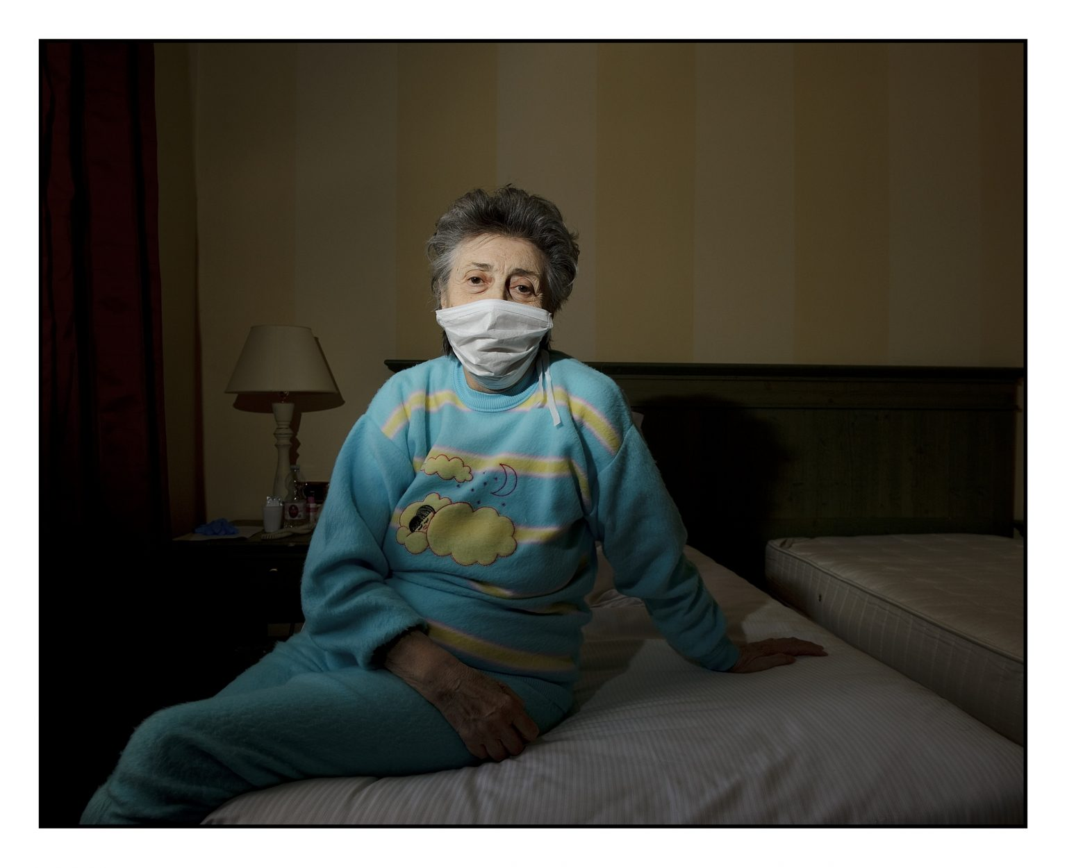Ms. Pierluigia, guest of the room 430 of the Muratella S.r.l hotel during her quarantine, being Covid-19 positive. This hotel is one of the few ones of the province where people who have developed the virus are welcomed. Everyone remains isolated and after fourteen days, if the course of the disease is over and he tests negative for the swabs, he can go home. Cologno al Serio, Bergamo province, April 15th 2020