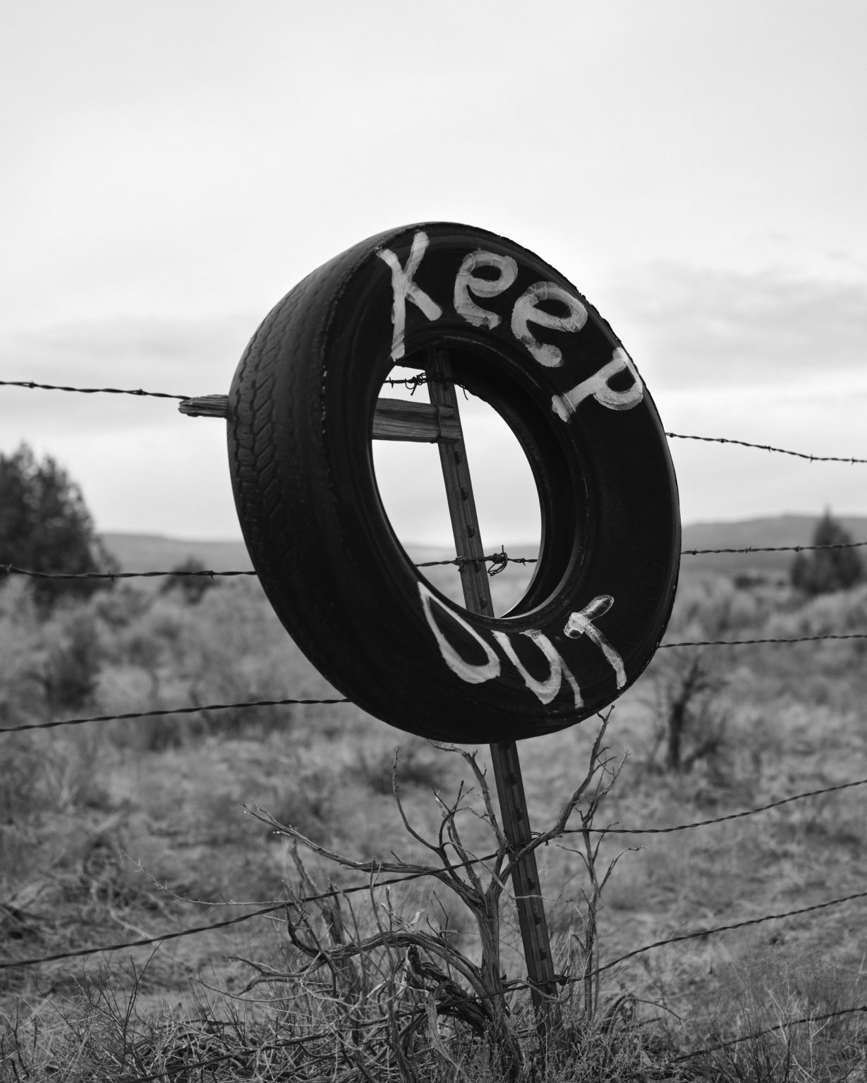Keep out tire on fence surrounding private land. Utah, 2020