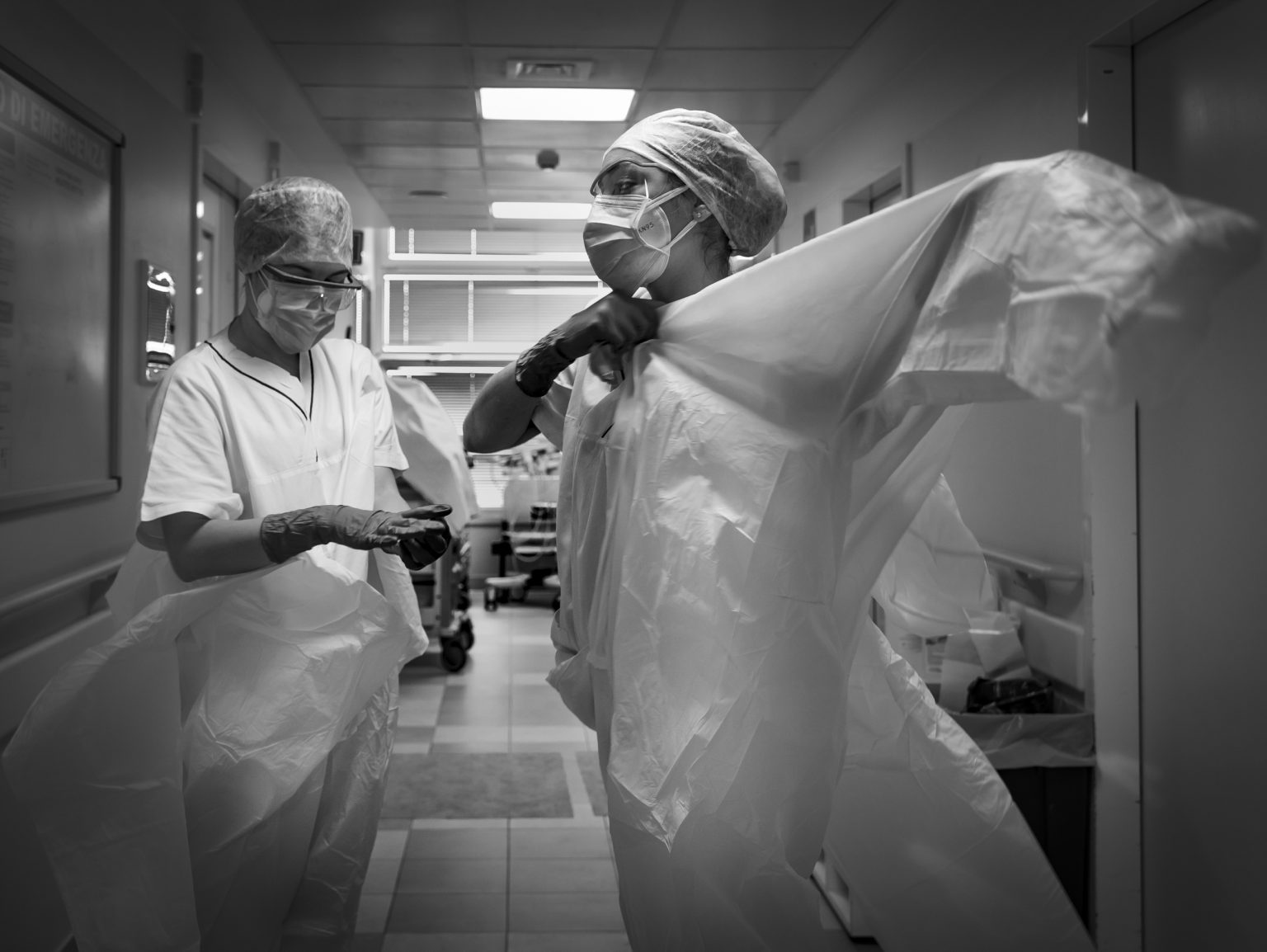 The General Hospital. Complex Structure Respiratory Tract Diseases. Sub-Intensive Care. Pneumology. Nurses dressing up before entering the negative pressure rooms housing severe Coronavirus patients. Modena, Italy, 2020