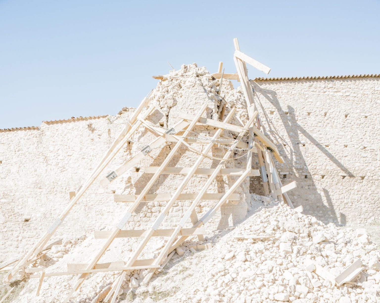 Norcia (Perugia), 30 October 2016. The provisional structure shoring up one of the bastions of the town walls, installed after the earthquakes of 26 October, collapsed after the earthquakes of 30 October. Norcia, Perugia, Italy 2016.