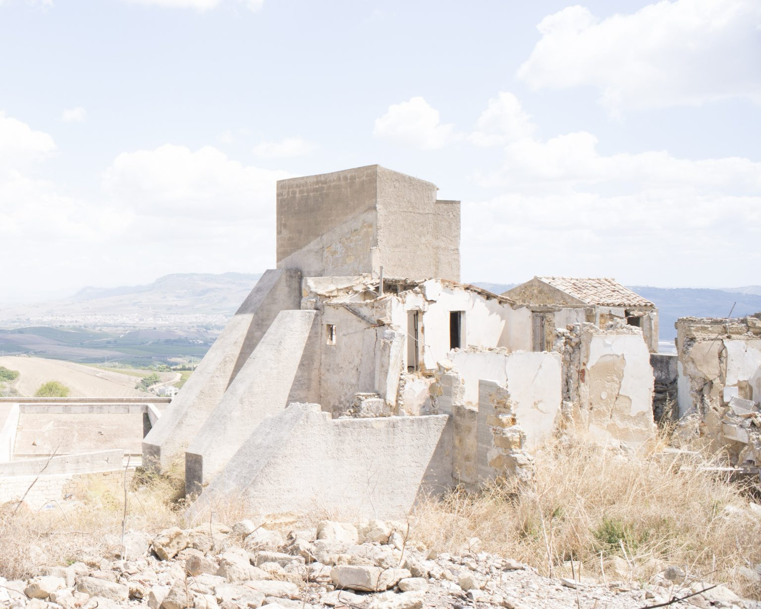 Francesco Venezia's project for the open-air theatre. In the foreground, emergency structures to stabilize some ruins caused by the earthquake of 1968; in the background, the valley of Belíce with the new town of Gibellina. Salemi, Trapani, Italy, 2018