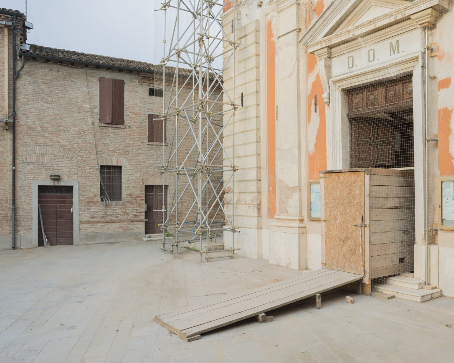 Church of San Felice Vescovo Martire after the earthquake in 2012. Wooden structure to provide safe access to the church. San Felice sul Panaro, Modena, Italy, 2016