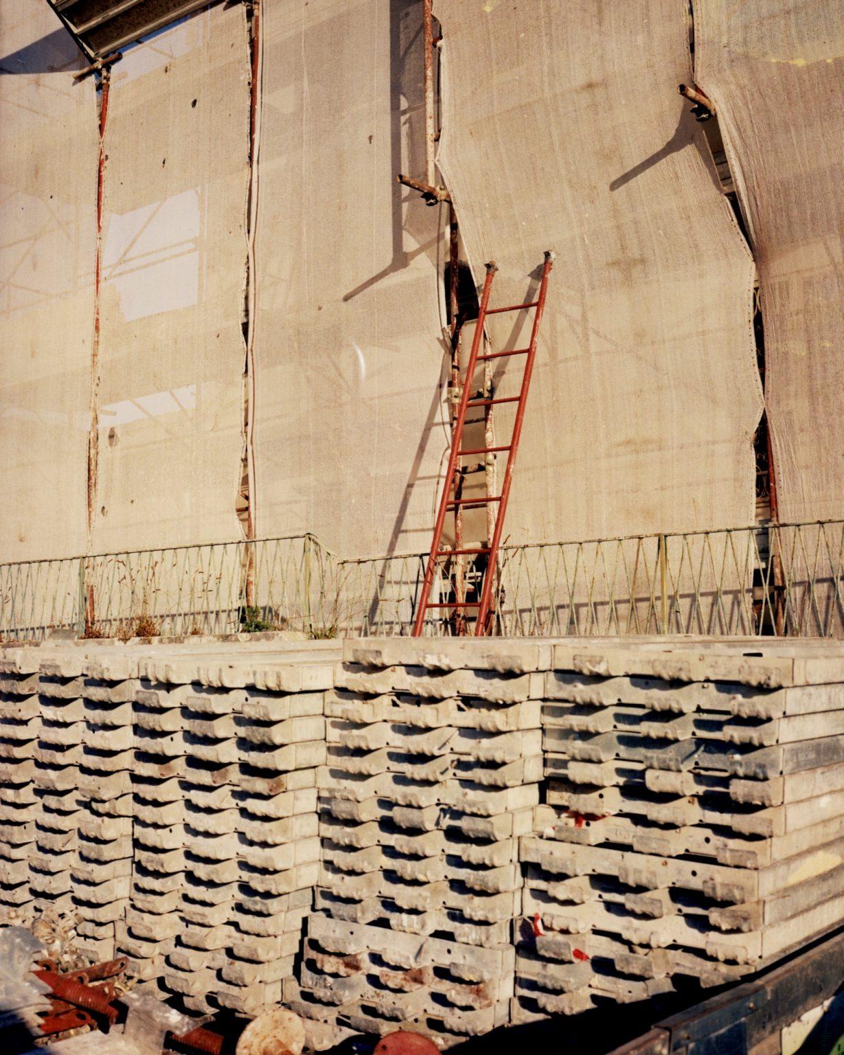 Ladder and scaffolding in construction zone. Paesi Vesuviani, Province of Naples. 2020