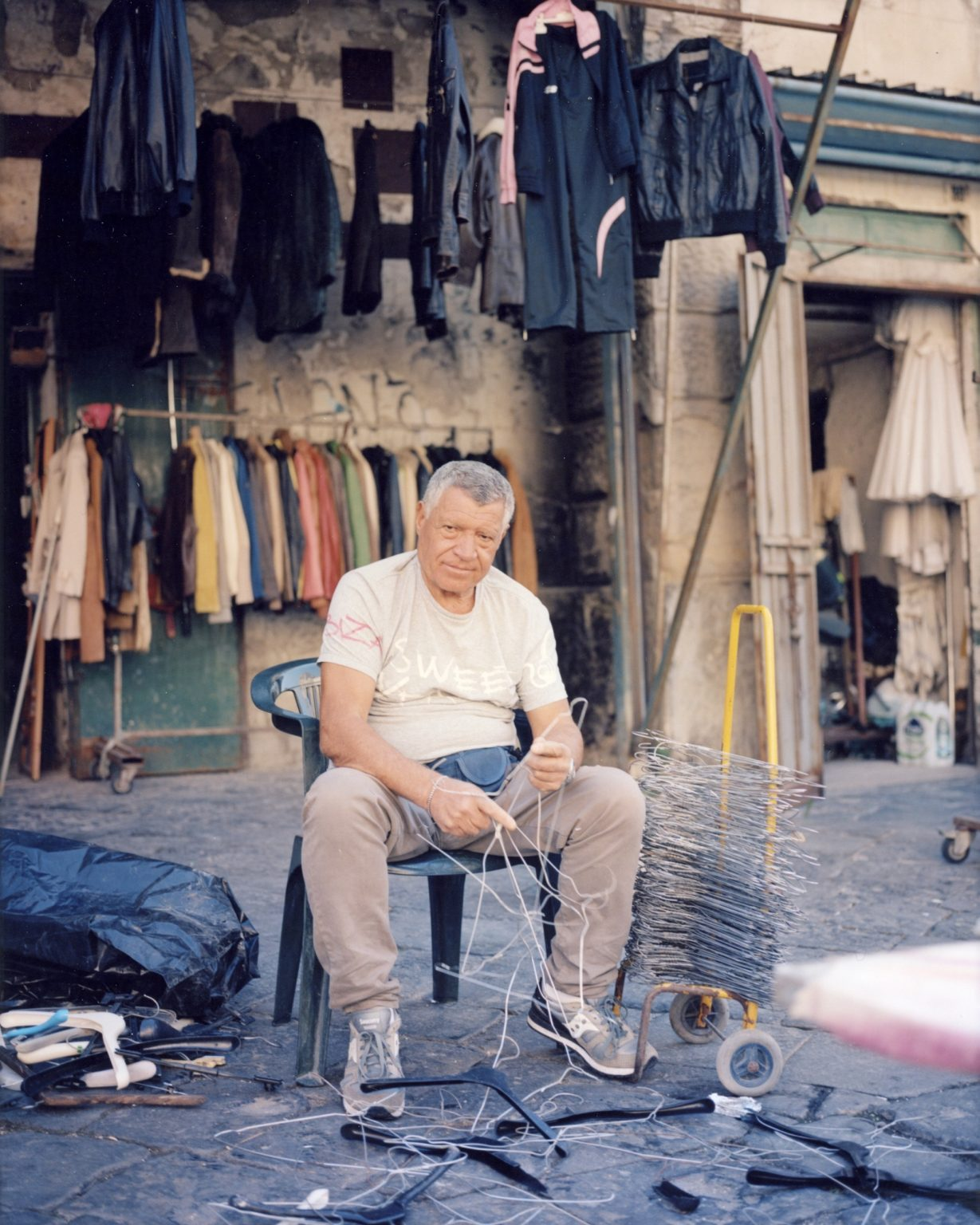 Coat salesman at the Meracato di Resina. Paesi Vesuviani, Province of Naples. 2020