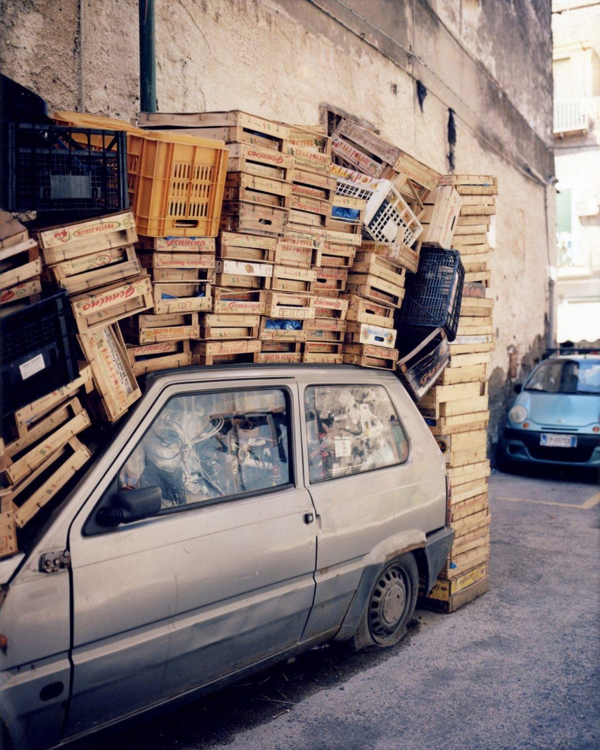 Fiat Panda covered by vegetable boxes. Paesi Vesuviani, Province of Naples. 2020