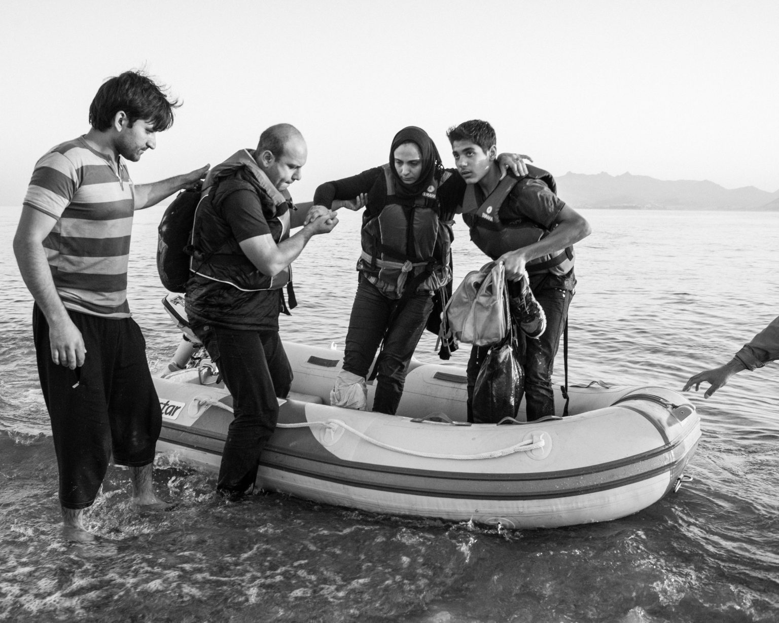 A Syrian refugee family arriving on the island of Kos from Turkey on a dingy. Kos, Greece, 2015