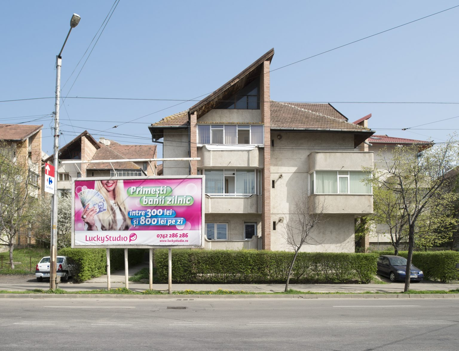 An advertisement billboard in a street of the city promising daily earnings for the cam models between 300 and 800 RON (approx. between 66 and 178 euros). Iași, Romania, 2016