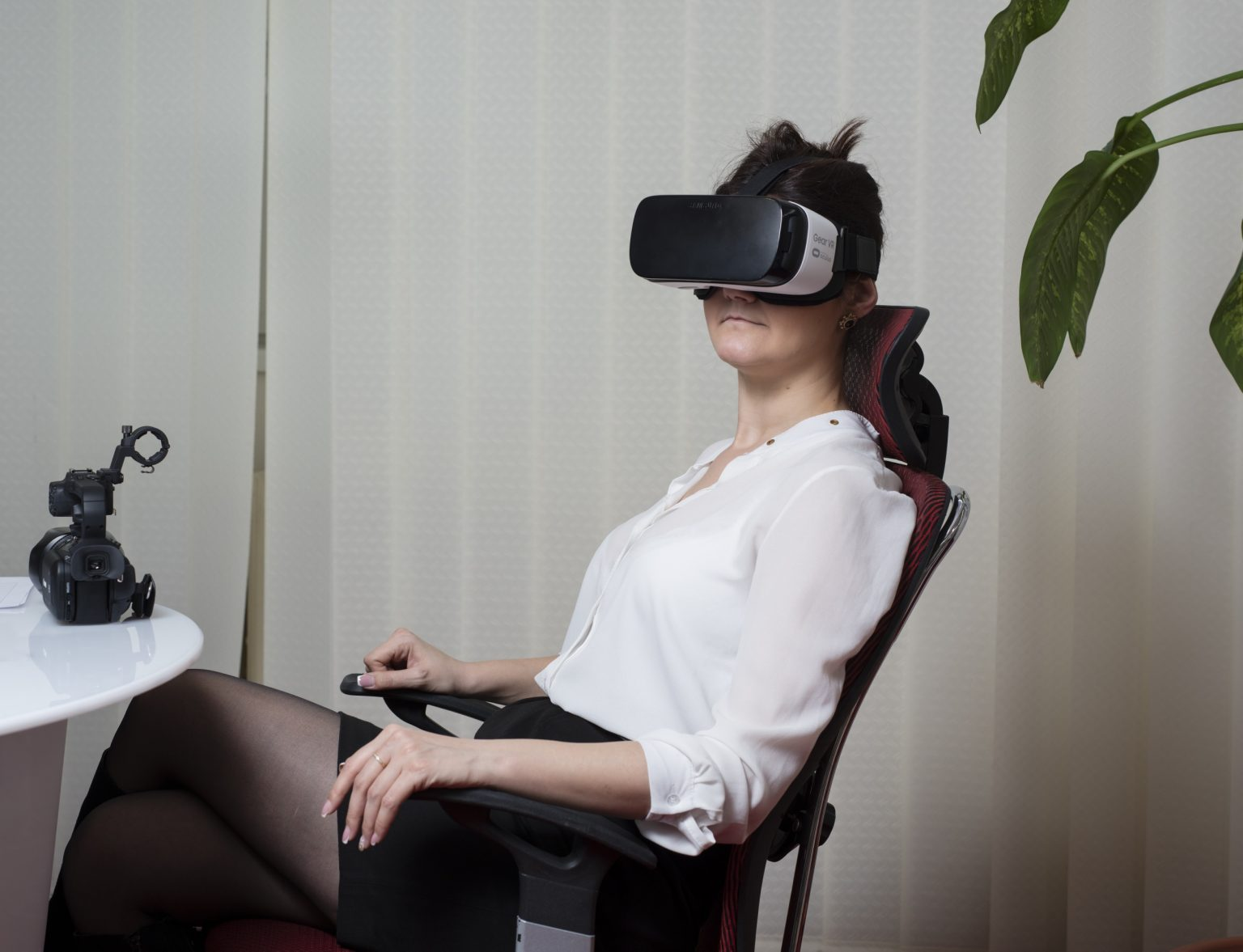 """Pc operator in the office of the """"Studio 20"""" checking the work of a cam model in the virtual reality room."""