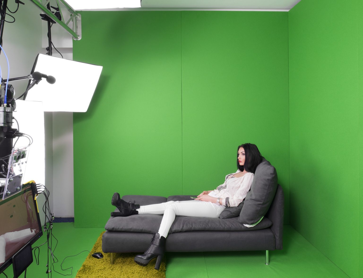 """A 25 years old cam model in the virtual reality room at """"Studio 20"""" before her night shift. Bucharest, Romania, 2016"""