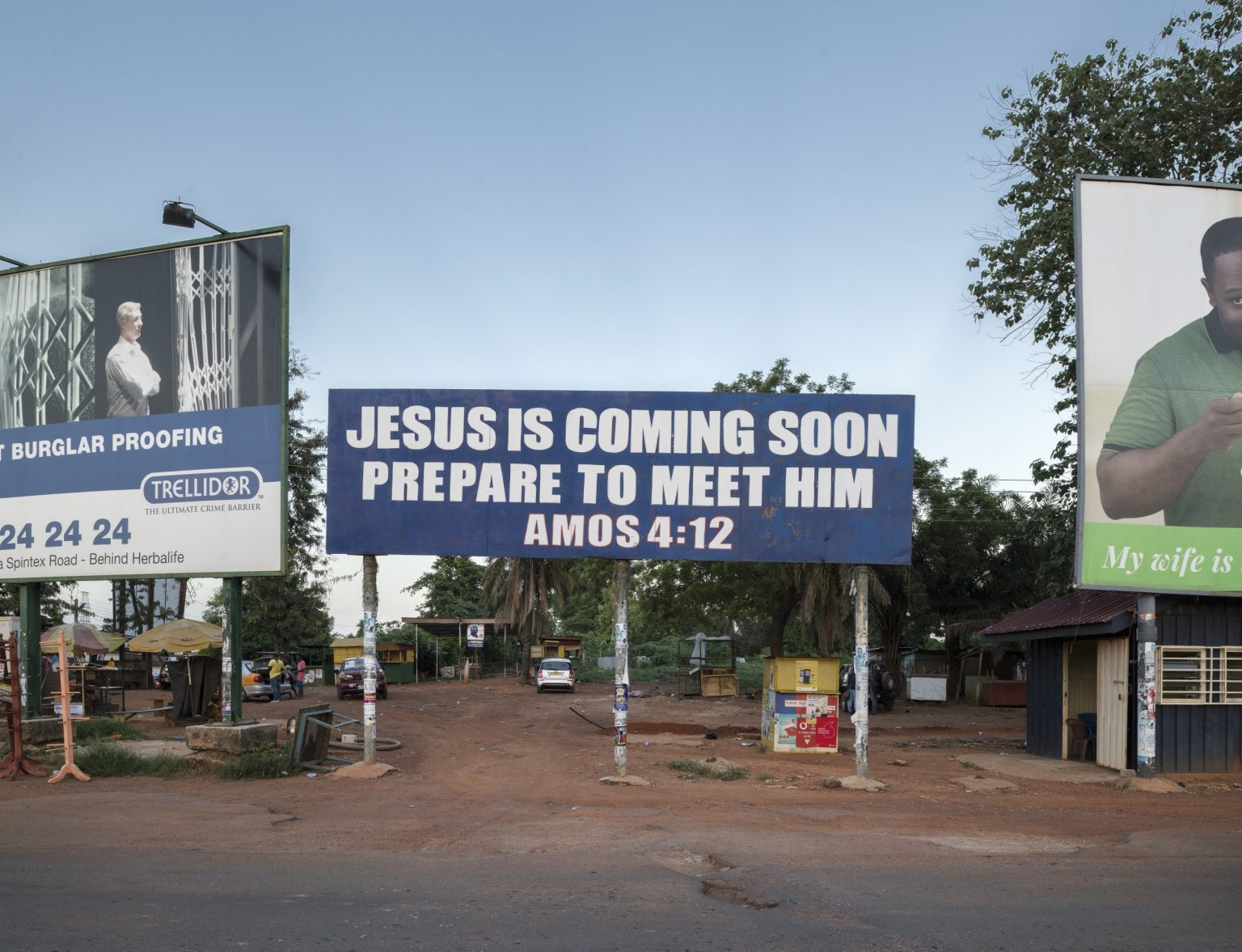Billdoard on a street of the city. Kumasi, Ashanti Region, Republic of Ghana, 2019
