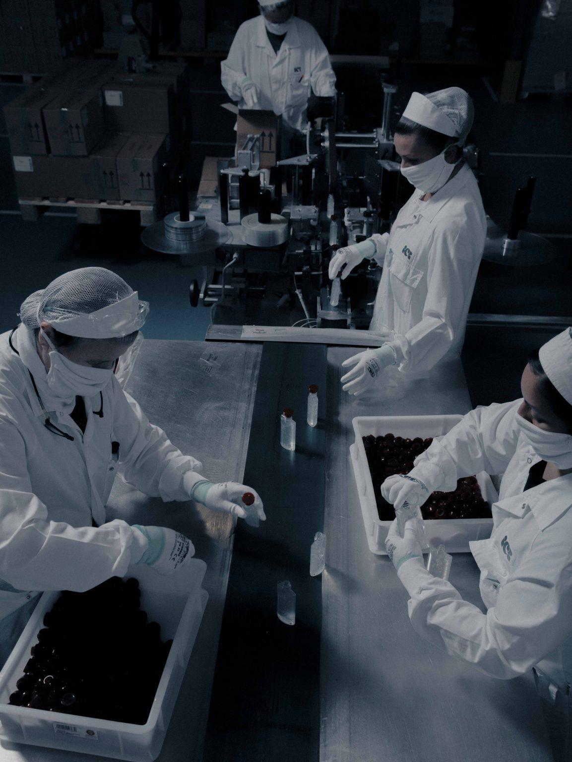 April 16th, 2020  Inside ICS S.p.a. (Industrie Cosmetiche Riunite), in Lodi, Lombardy.  ICS started producing hand disinfectant on behalf of the luxury brand Bulgari in response to the COVID 19 outbreak.  16 aprile 2020  All'interno di ICS S.p.a. (Industrie Cosmetiche Riunite), a Lodi, Lombardia. ICS ha iniziato a produrre disinfettante per le mani per conto del marchio di lusso Bulgari in risposta all'epidemia di COVID 19.  In questa immagine: una delle due linee di produzione attive, dove il disinfettante viene imbottigliato da un processo parzialmente automatizzato.