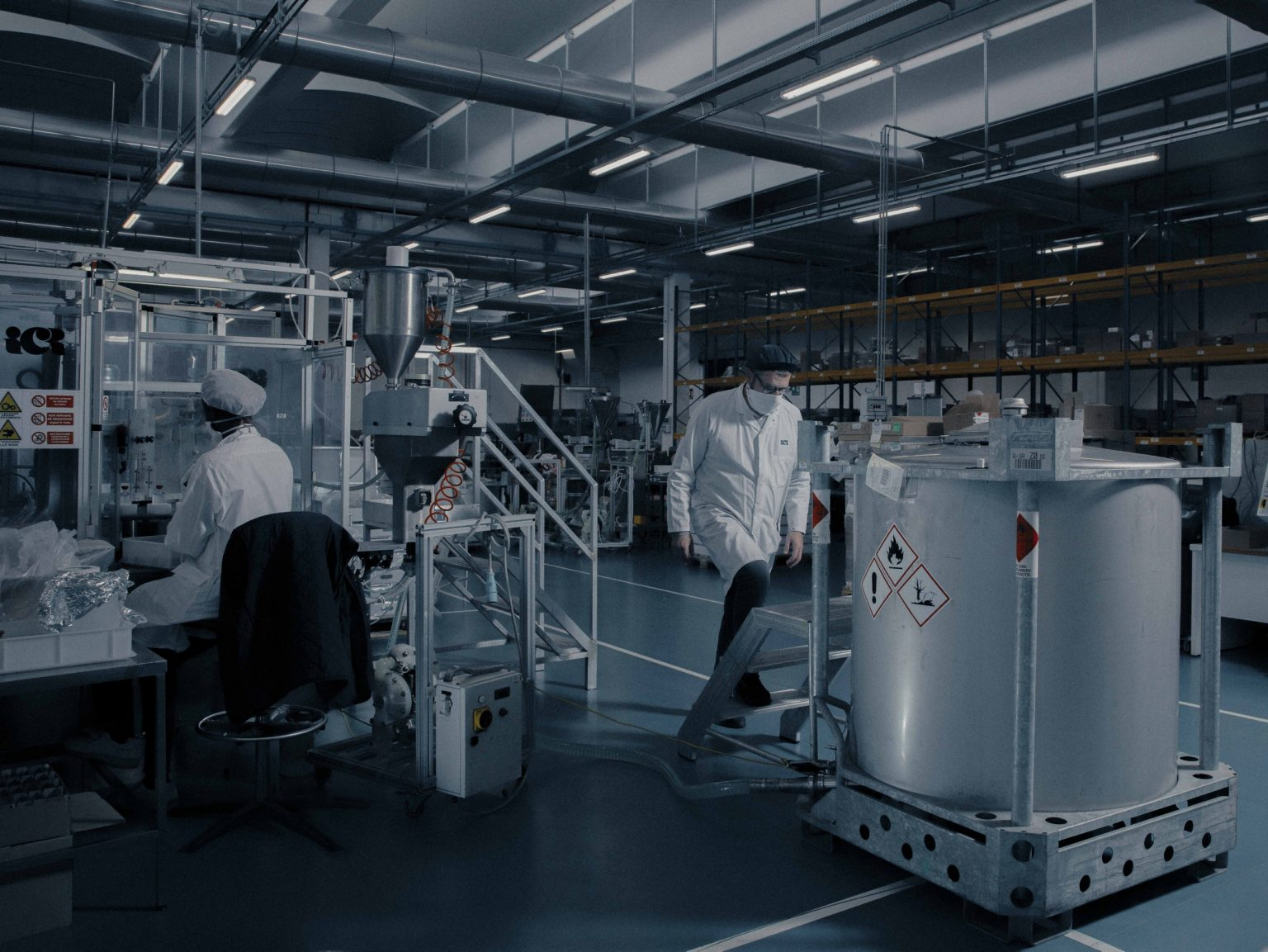 Inside ICS S.p.a. (Industrie Cosmetiche Riunite), in Lodi, Lombardy.  ICS started producing hand disinfectant on behalf of the luxury brand Bulgari in response to the COVID 19 outbreak. In this image: a man inspecting the large tanks containing disinfectant before it gets bottled in the smaller containers. Italy, April, 2020