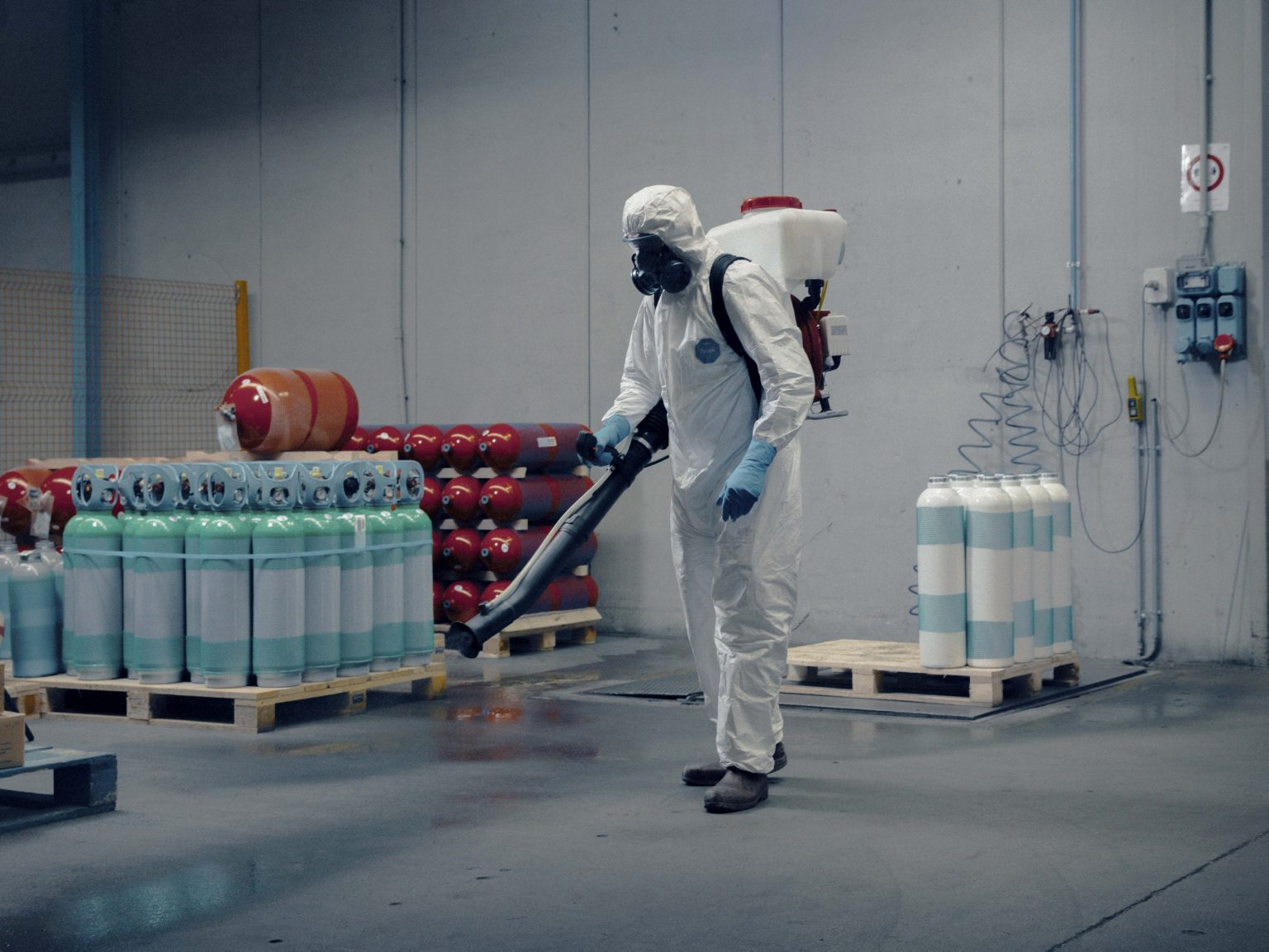 Faber is a company specialized in producing cylinders for different types of content in medical use.  Its 330 employees work on three shifts, 24 hours a day. All production has been moved to the cylinders for medical gases, especially oxygen, essential for anticoronavirus therapies. In this image: a worker spraying disinfectant in different areas of the factory to avoid spreading of the virus. Cividale del Friuli, Italy, 2020