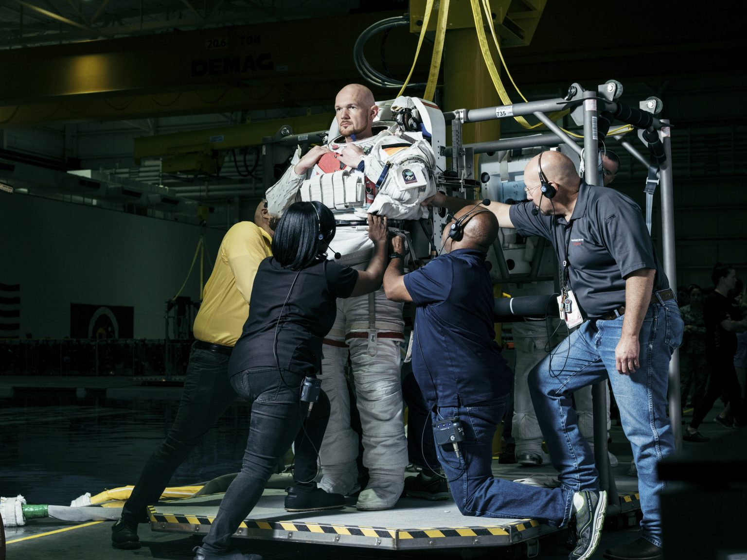 German astronaut Alexander Gerst at the NASA Neutral Buoyancy Laboratory, an astronaut training facility with a pool containing a 1:1 replica of the International Space Station. In this image Gerst is preparing for a long underwater training in preparation for Expedition 57. NASA Johnson Space Center, Houston, Texas, USA, 2018