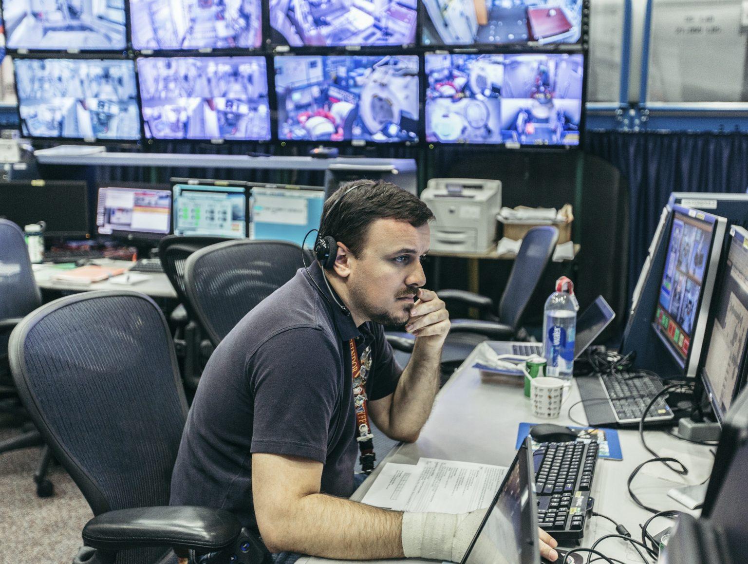 A supervisor during an ISS simulation training.  NASA Johnson Space Center, Houston, Texas, USA, 2018