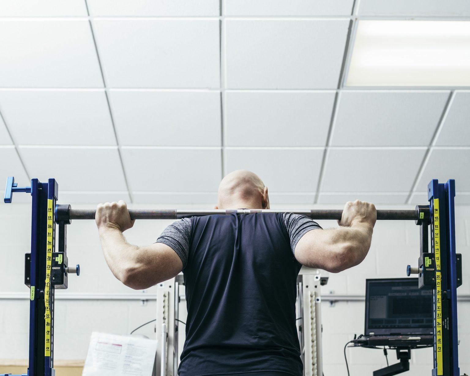 Alexander Gerst training at the gym labs. The devices are identical to the ones present at the ISS, where in absence of gravity body weight needs to be simulated trough extra weight. NASA Johnson Space Center, Houston, Texas, USA, 2018