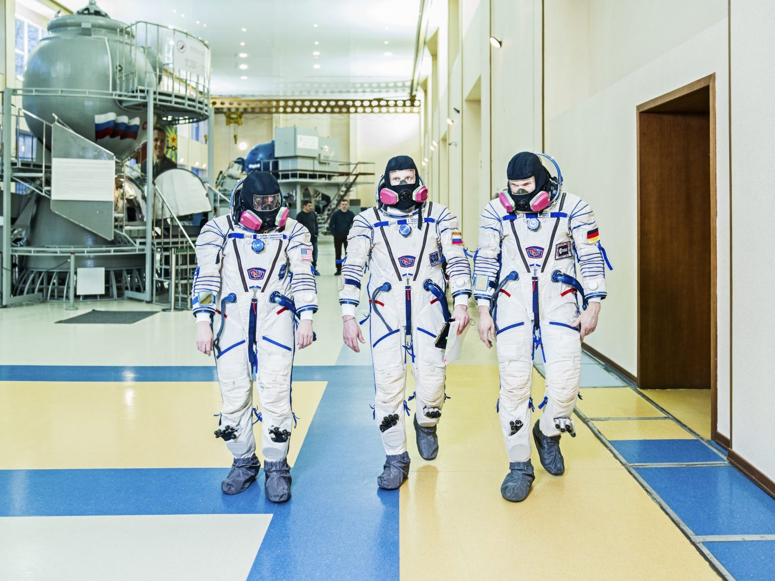 From left to right astronauts: Serena M. Auñón-Chancellor (NASA), Alexander Gerst (ESA), Sergei Prokopyev (Roscosmos) walking toward the Soyuz Simulator. Star City, Russia, 2018