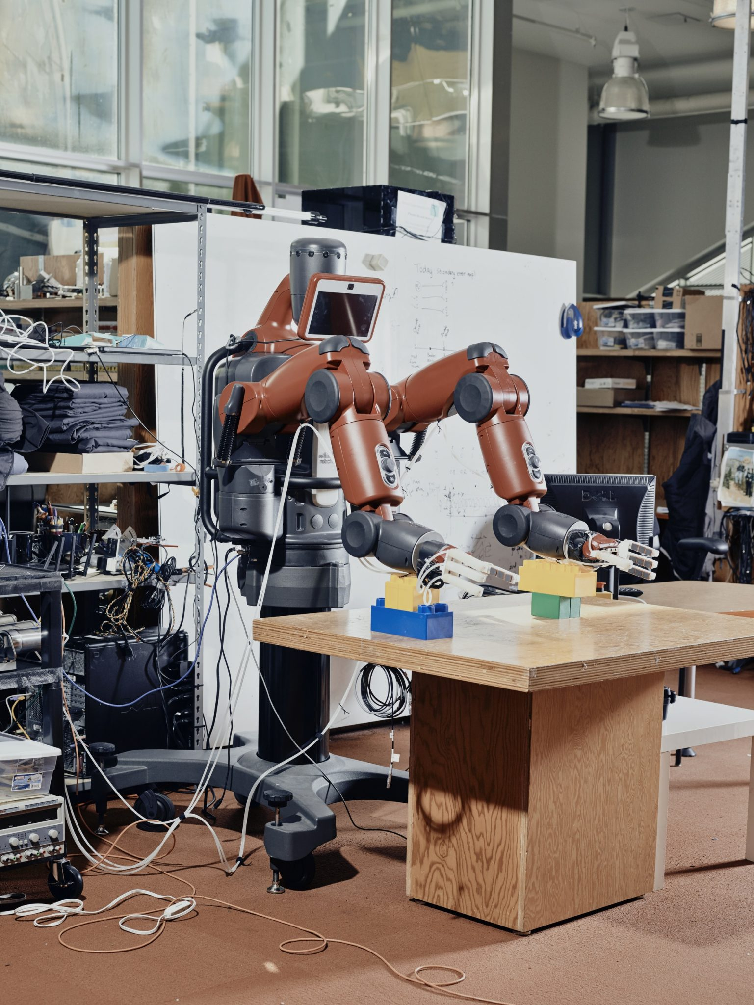 Researchers at the Computer Science and Artificial Intelligence Laboratory at MIT have designed a system that allows Baxter to use a person's brain waves and hand gestures to make decisions and act on them. Massachusetts Institute of Technology, Cambridge, USA, 2017