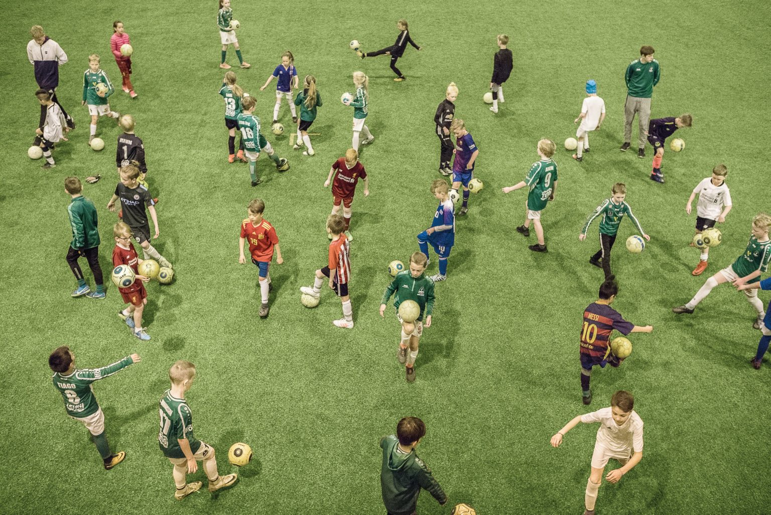 When the weather it's bad, up to 200 children at the same time train on the indoor Breidablik field. Kópavogur, Iceland, 2018
