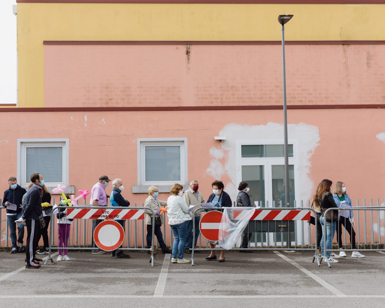 Queue of the inhabitants of Vo' outside G. Negri Primary School, where all the community of Vo' were tested. Vo', Padua, Italy, 2020