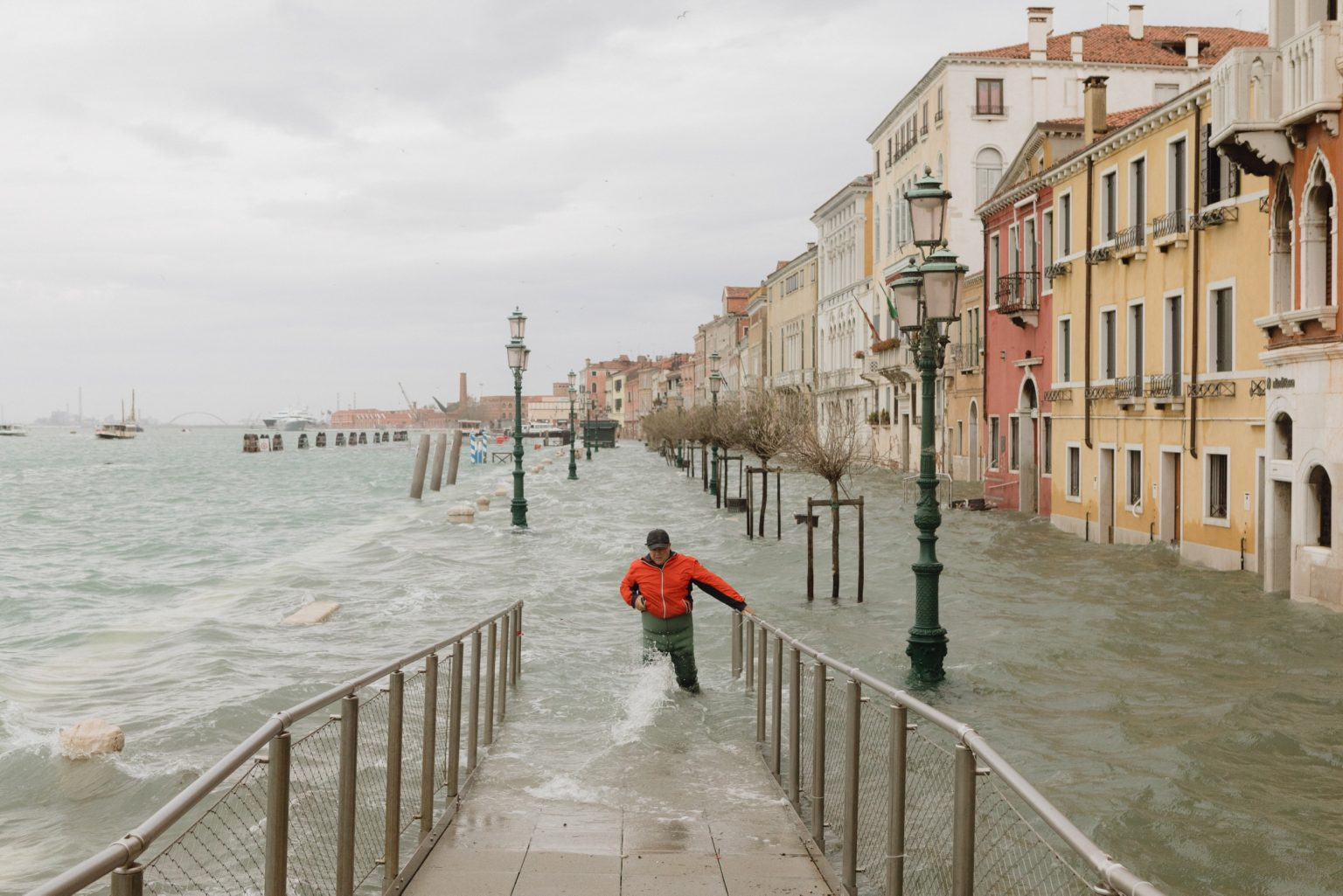 A man reaches a bridge in the Zattere shore, when water of the Giudecca Canal invaded the city. Exceptional acqua alta, or high water, in Venice, where the tide went up to 187cm, the highest level since the 1966 flood. Brugnaro, the mayor declared a state of disaster. Venice, Italy, 2019