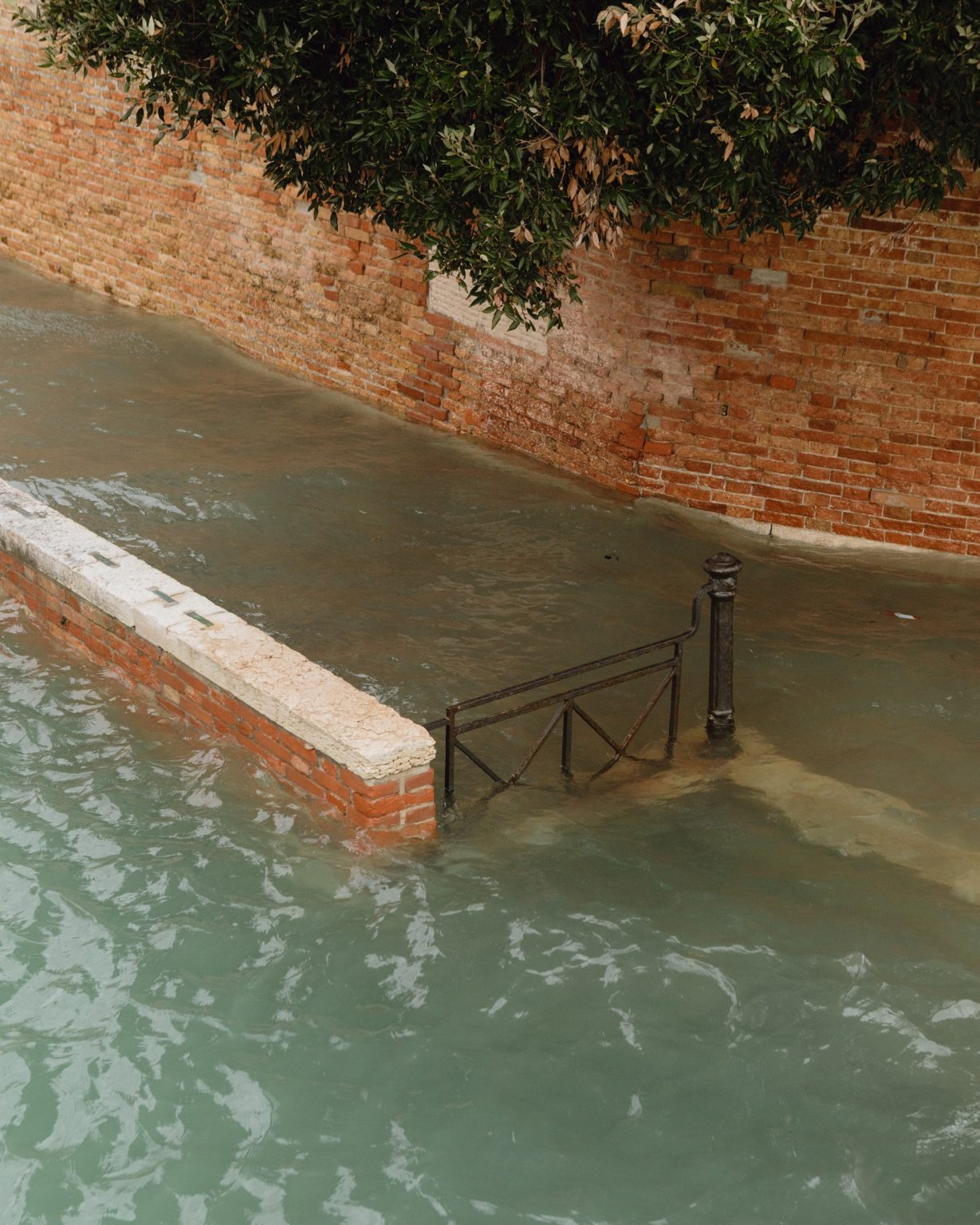 The water of Giudecca Canal invading the Fondamenta Zattere. Exceptional acqua alta, or high water, in Venice, where the tide went up to 187cm, the highest level since the 1966 flood. Brugnaro, the mayor declared a state of disaster. Venice, Italy, 2019