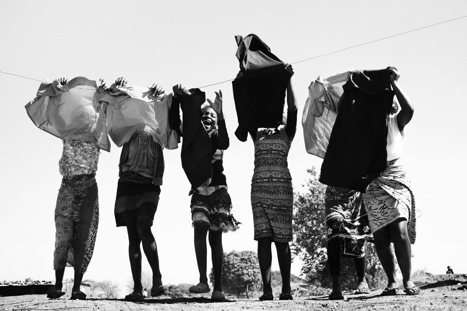 The girls from Loniedzani hang out their school uniforms. Lusaka, Zambia, 2019