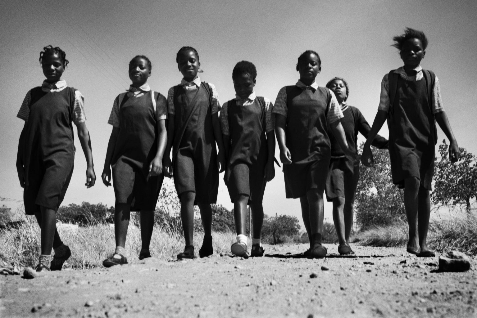 After having breakfast, the girls from Lonjedzani walk to school. Lusaka, Zambia, 2019