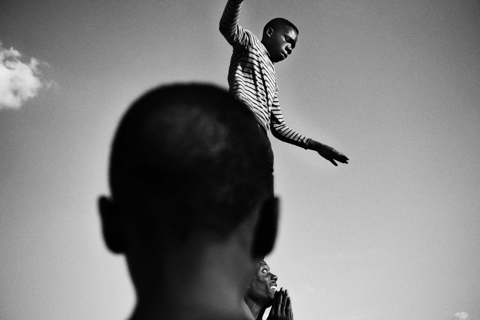 The human tower: Mthunzi's acrobats practice every day. Lusaka, Zambia, 2019