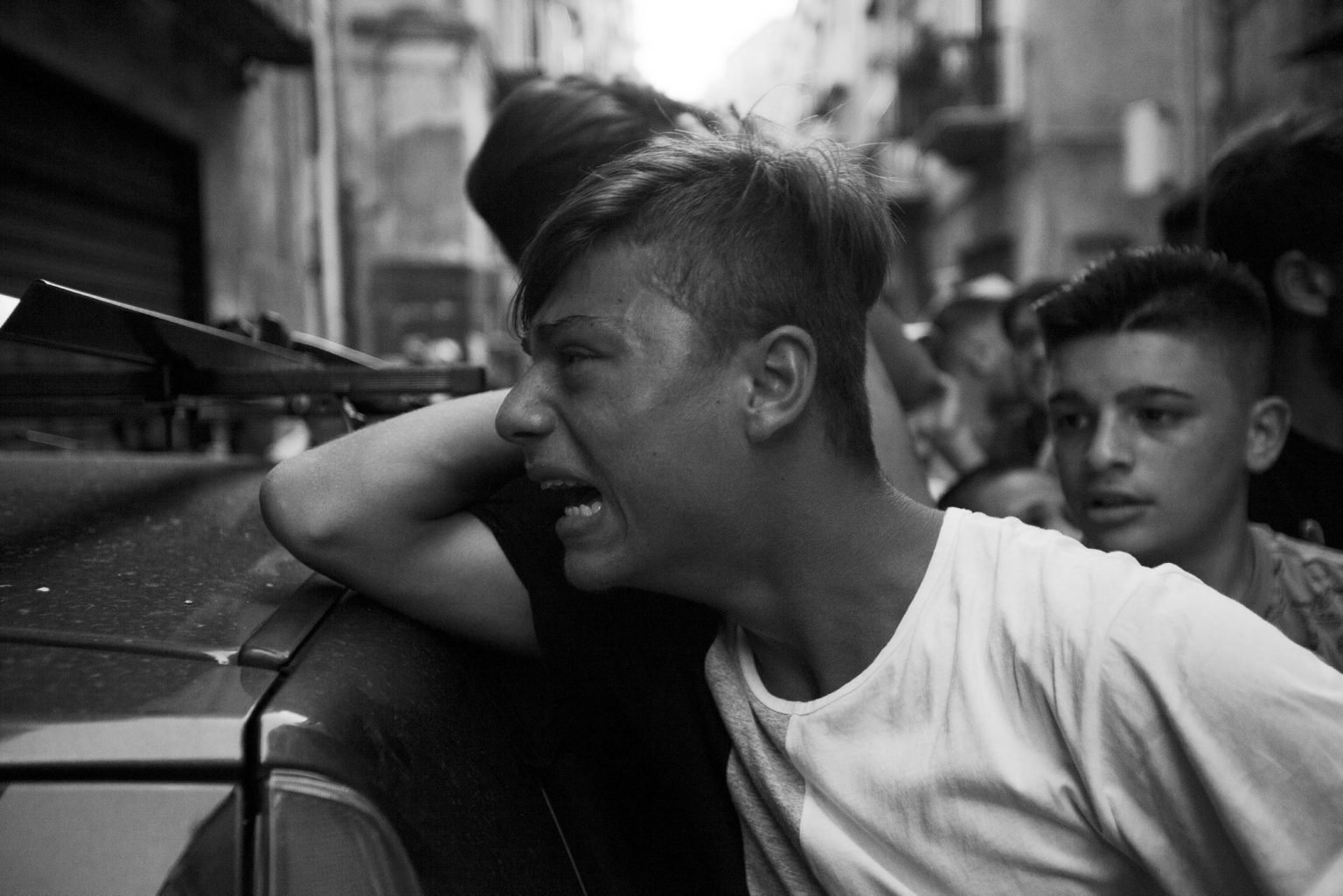 Genny Cesarano a 17 years old guy with previous convictions for robbery and possession of gun, was killed by a Camorra commando. The funeral of Genny, the friends bringing the coffin  in the streets of the quarter. Sanità neighborhood. Naples, Italy, 2015