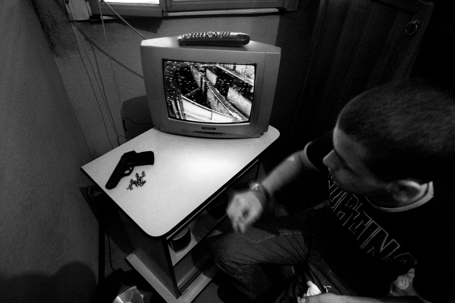 A close circuit camera in a pusher's home to watch the possible arrival of the police. Scampia neighborhood. Naples, Italy, 2008