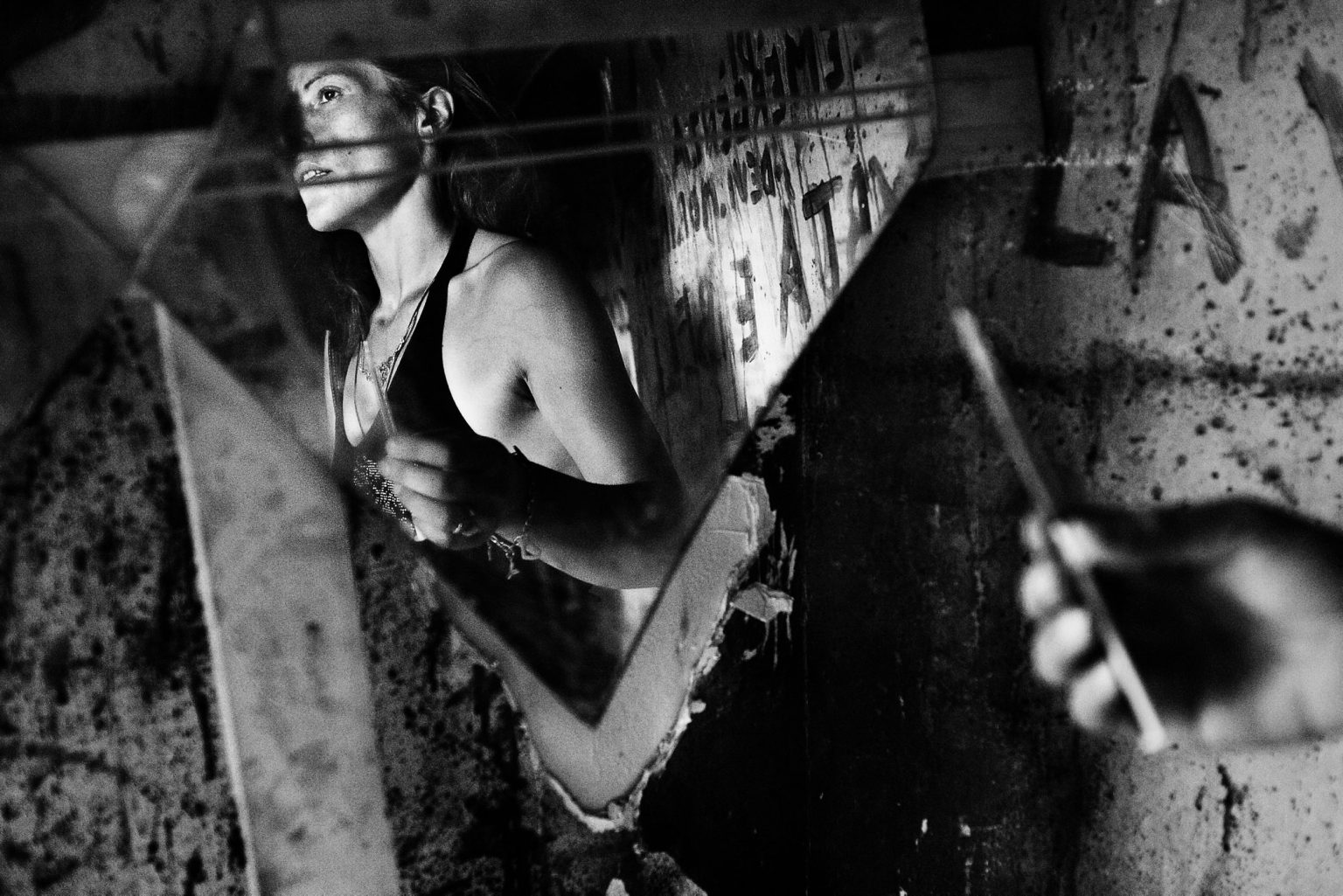 """Inside one of the housing blocks known as """"Le Vele"""", or Sails because of their shape.  Drug addict seconds before shooting a cocaine dose, in the abandoned houses that Camorra provide for  keep them away from the streets and do not alert the police. Scampia neighborhood. Naples, Italy, 2008"""