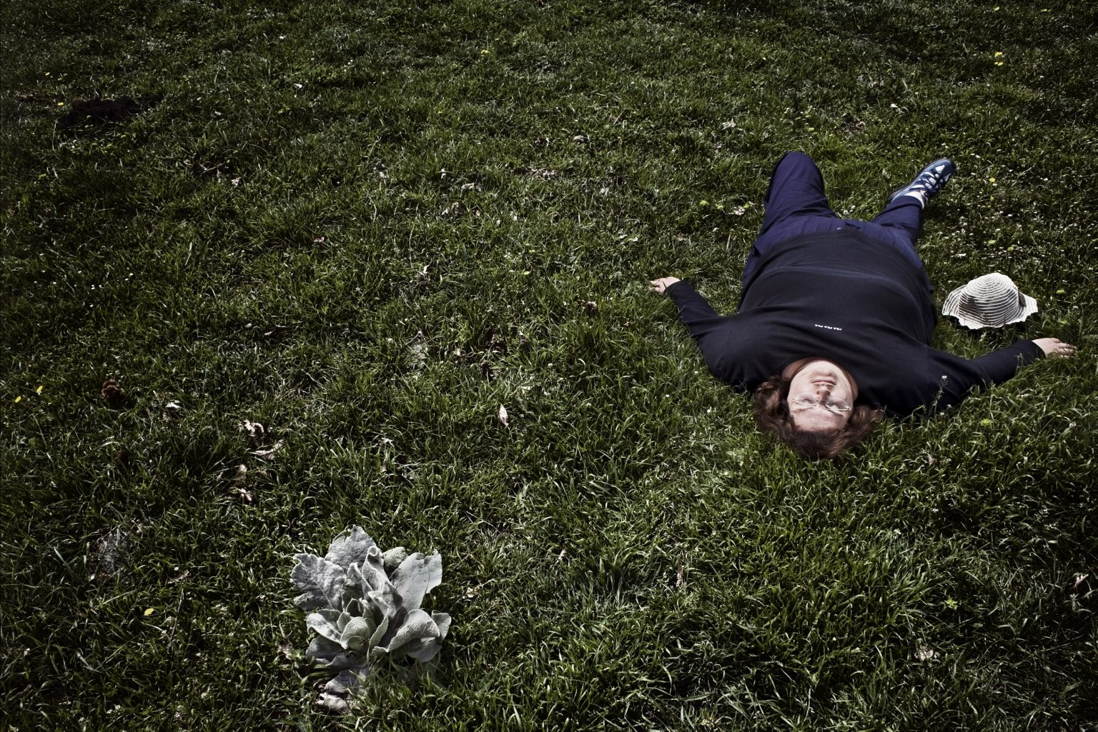 Angela lying on the lawn. Maccarese, Rome, Italy, 2008