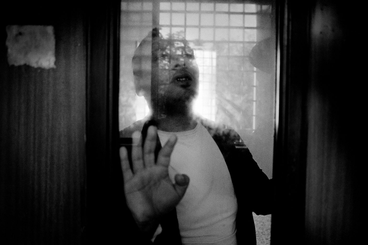 An inmate in solitary confinement. Judicial Psychiatric Hospital. Aversa, Caserta, Italy, 2006