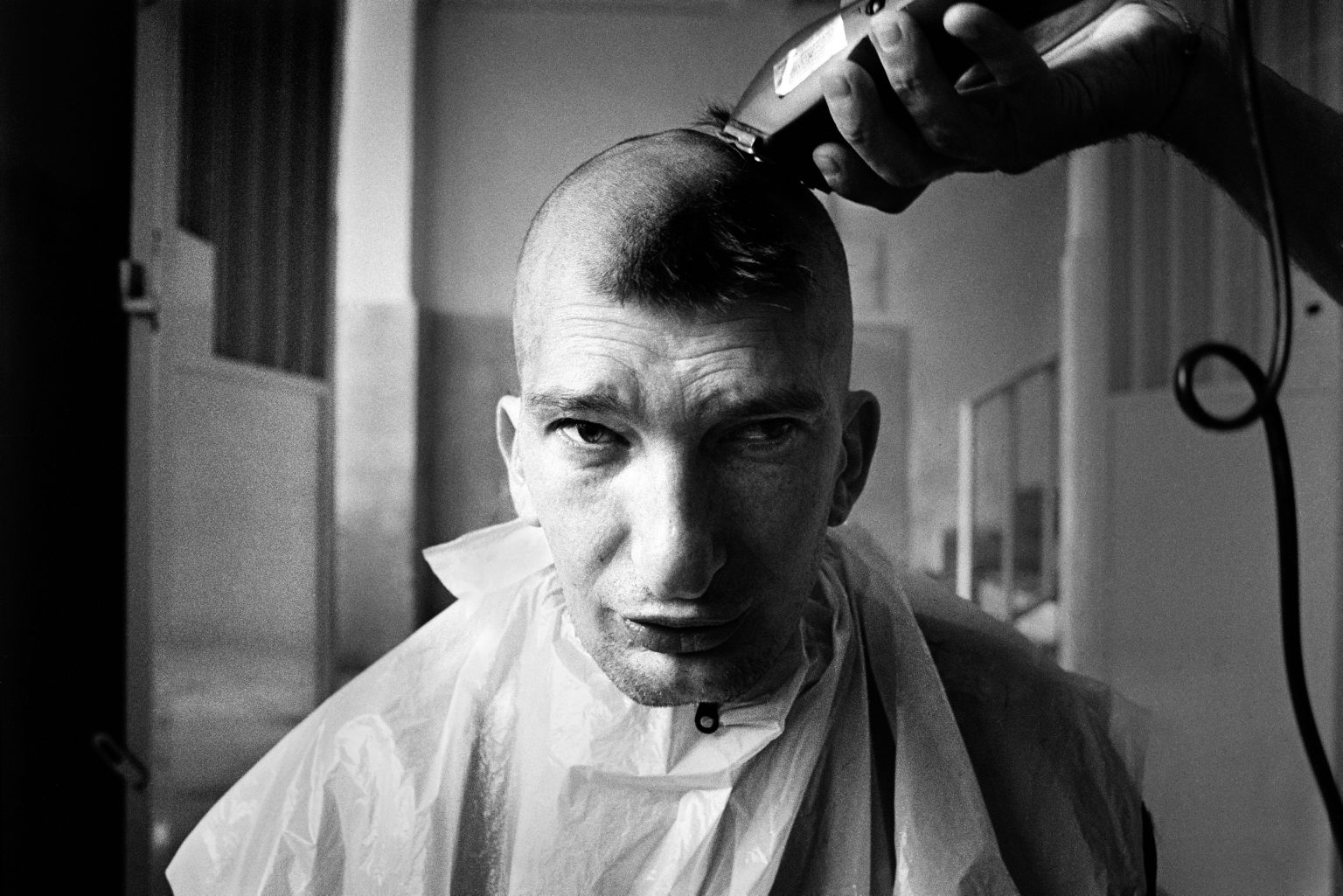 An inmate gets shaved by the institute's barber. Judicial Psychiatric Hospital. Aversa, Caserta, Italy, 2006