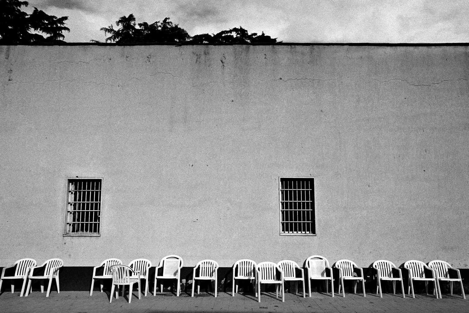 Chairs used by inmates to sunbathe in the hour of fresh air, courtyard of ward six. Judicial Psychiatric Hospital. Aversa, Caserta, Italy, 2007