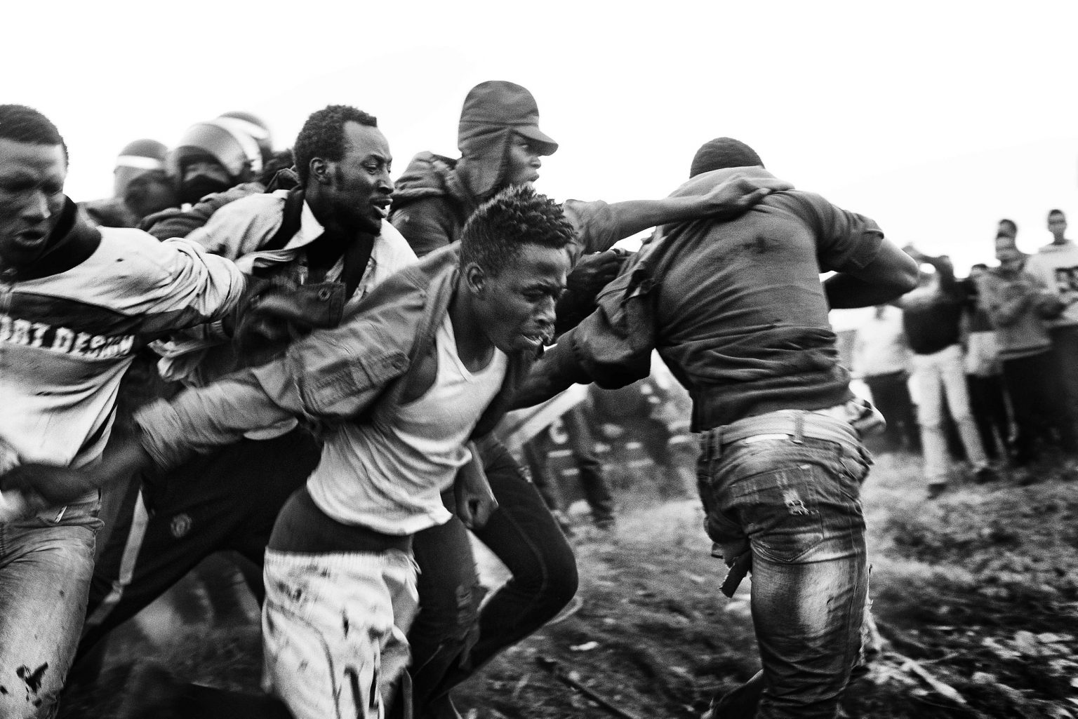 Some 20 sub-Saharan migrants manage to escape from the Police and start running through the fields next to the border. Despite the fact that these migrants had the right to stay in Spain since they touched the Spanish soil, the Guardia Civil and the Police  illegally expatriated most of those who crossed the fence.  Melilla, Spain, 2014