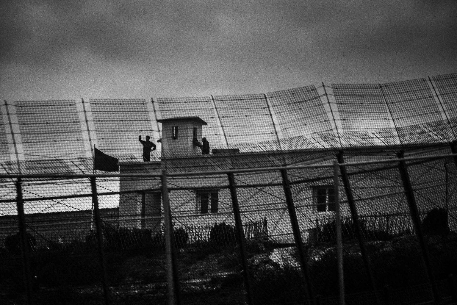 Moroccan soldiers patrol the border near Beni Enzar. Melilla, Spain, 2014