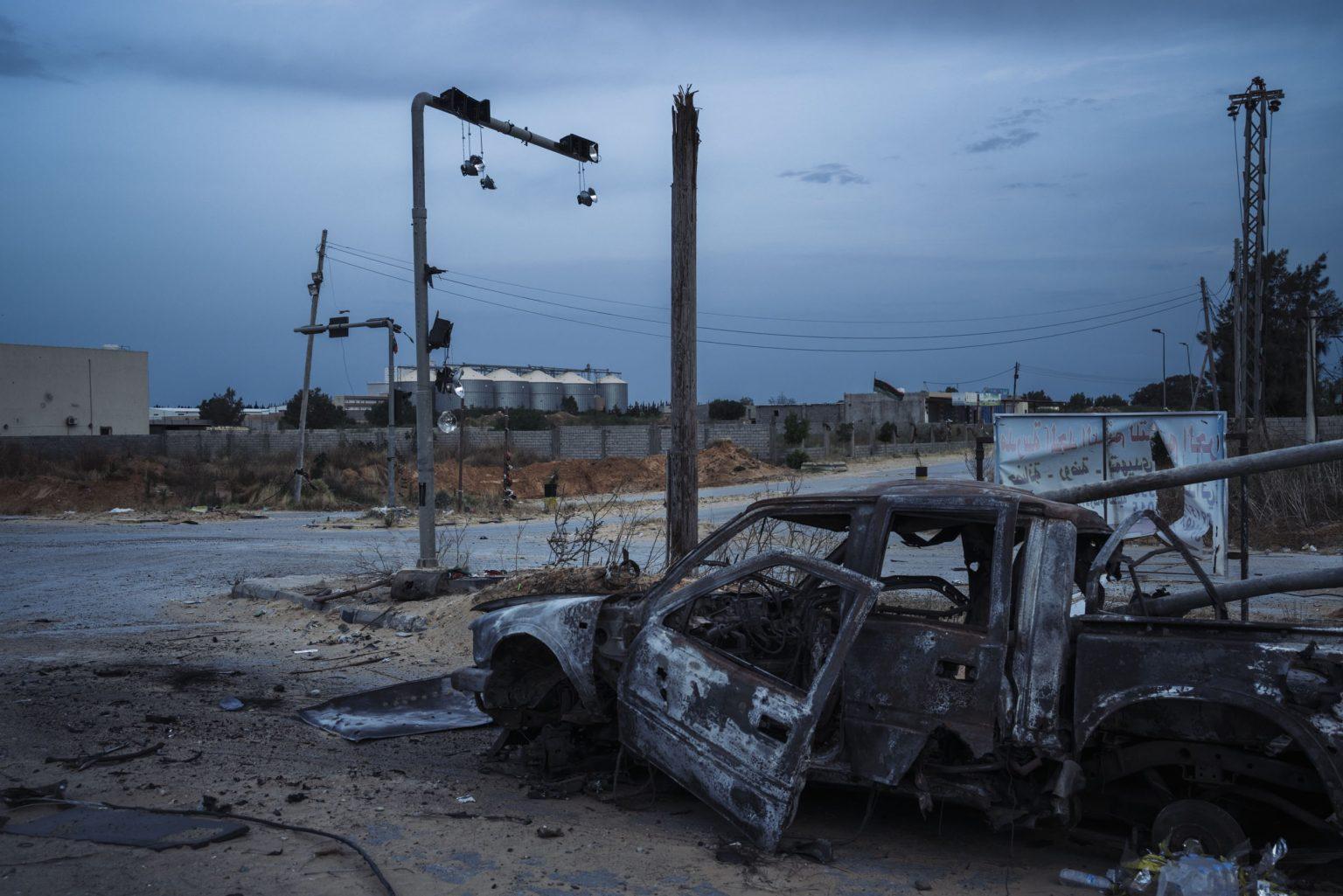 Tripoli, Libya, May 2019 - A damaged vehicle near al Qala frontline. >< Tripoli, maggio 2019 - Veicolo danneggiato vicino alla prima linea di Qala.