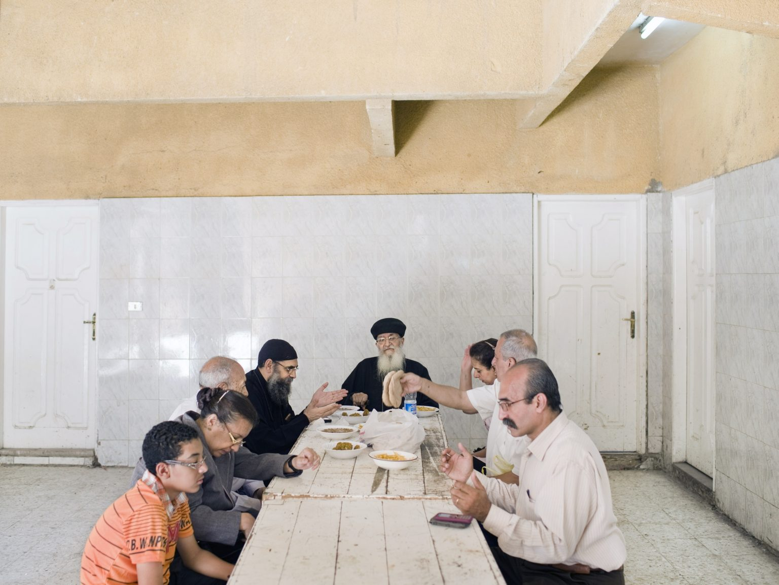 Coptic Christian family praying before lunch in the Coptic neighborhood in Cairo.