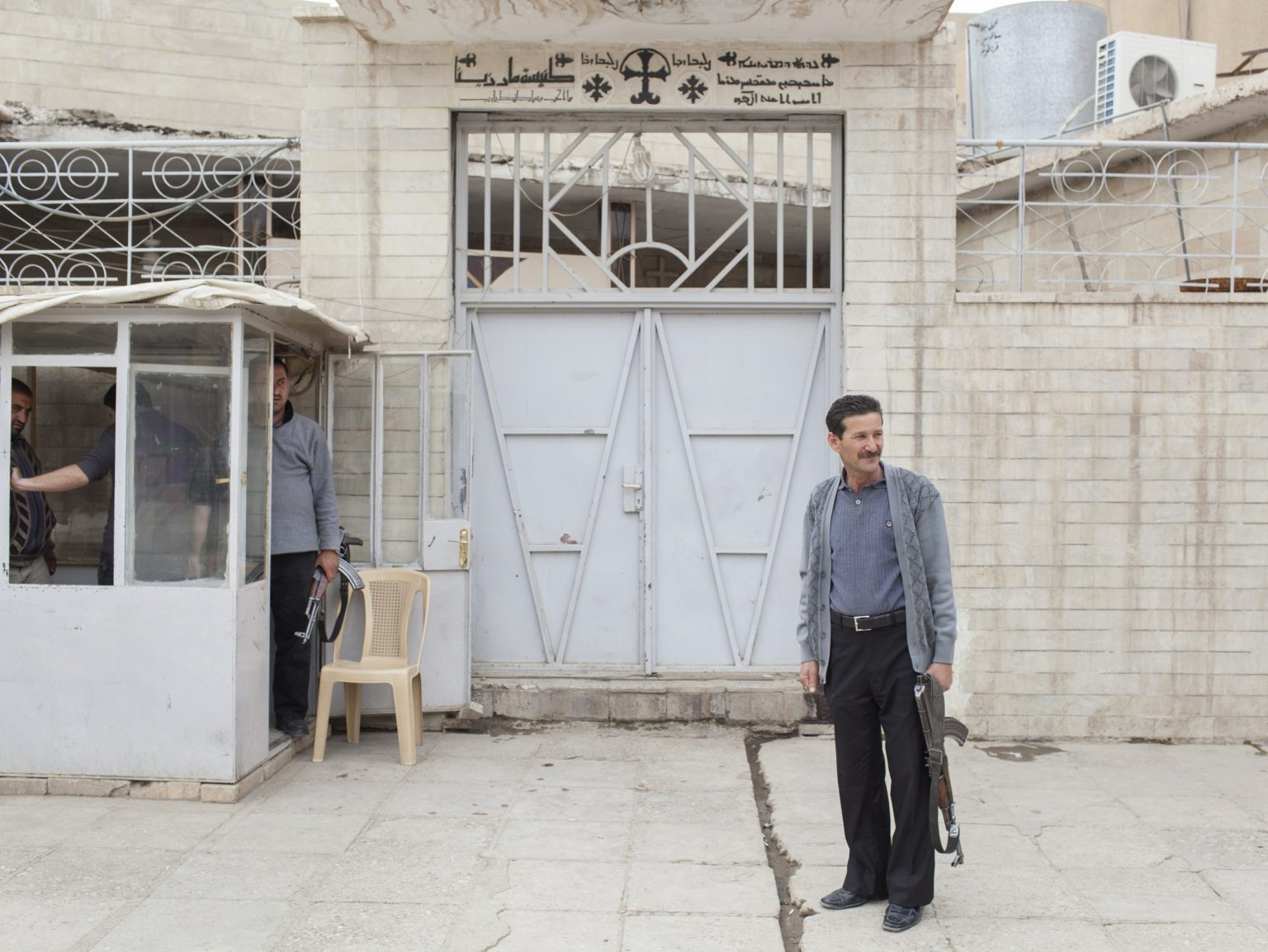 Members of the Christian militia patrolling the entrance to a church in the Christian town of Qaraqosh. The municipality of Qaraqosh has organized Christian militia in the city of Qaraqosh in order to protect the population from terroristic attacks.