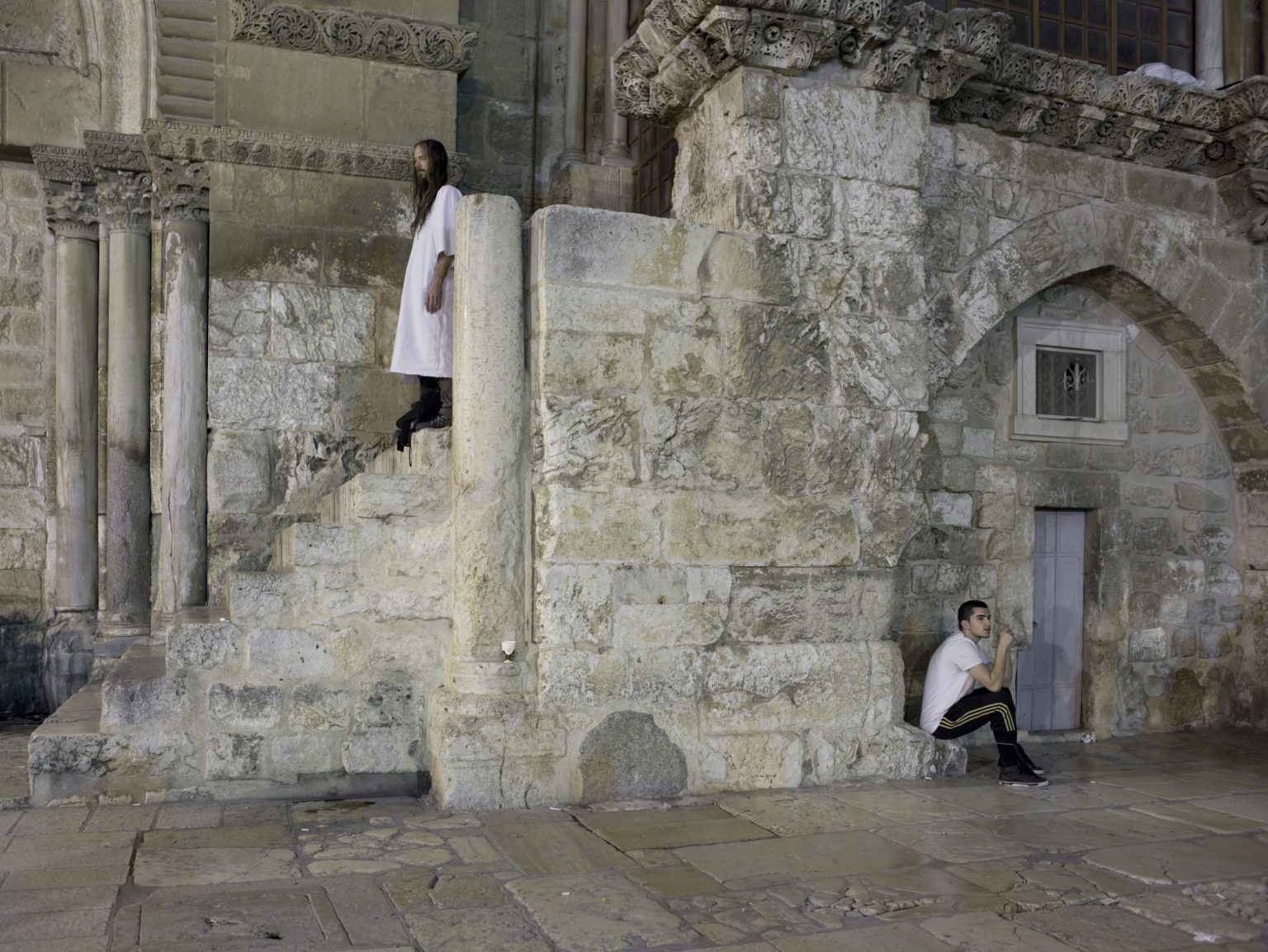 Pilgrims waiting at the entrance of the Holy Sepulchre in Jerusalem during Good Friday.