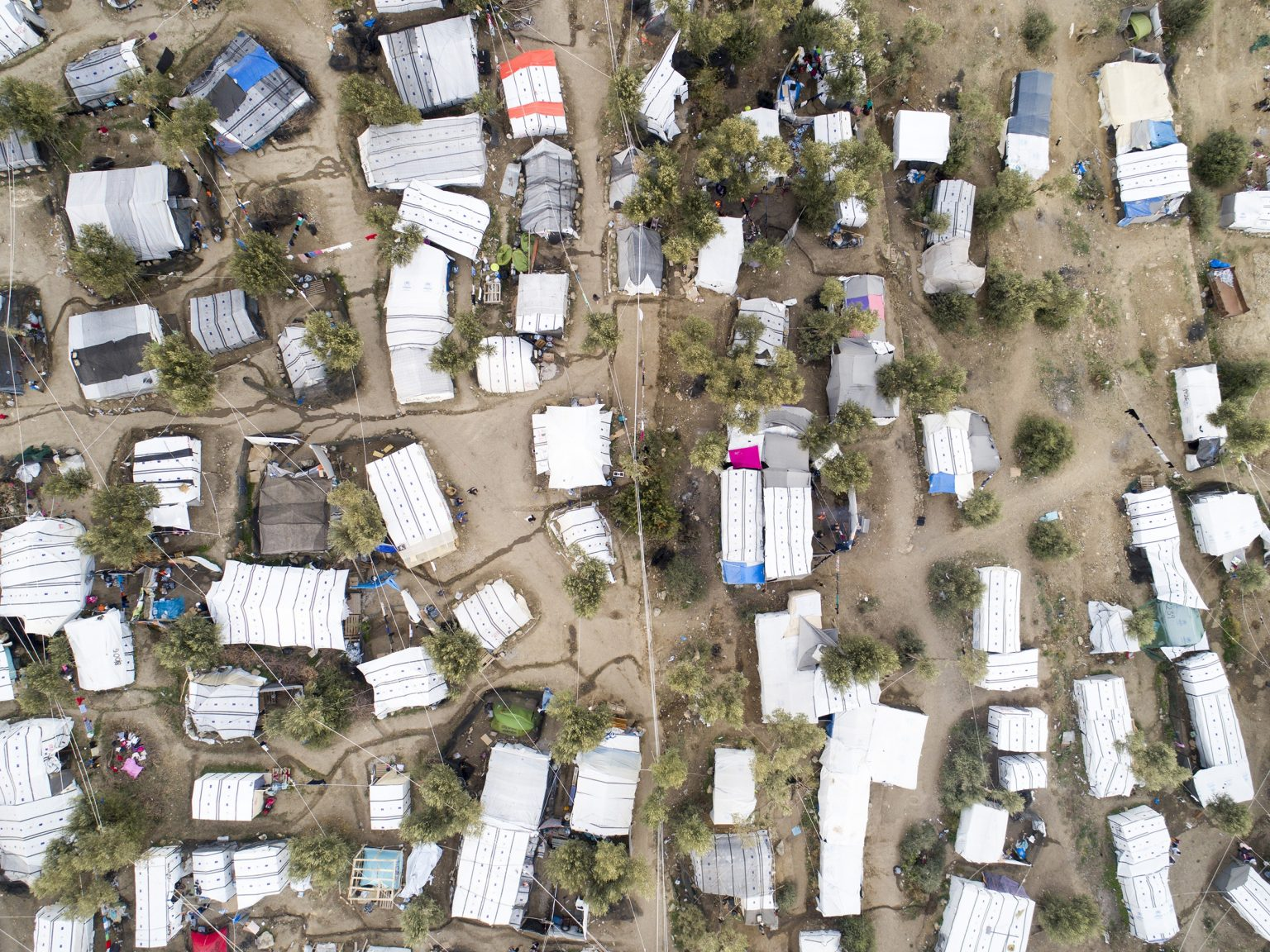 Moria, Greece. 5 November 2018. Tents in the unofficial migrant camp outside th governmental one. Located on the island of Lesbos, the refugee camp was built to host 3000 people, and is now giving shelter to about 13000 migrants, including 1000 minors.  Migrants keep arriving. In September 2019, 12,500 people arrived in Greece, and 40% of these came to Lesbos.