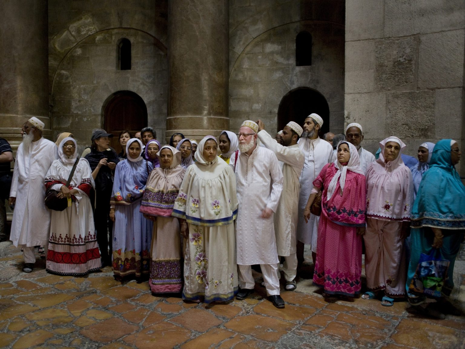 Christian pilgrims in the Church of the Holy Sepulcre in Jerusalem during the Holy week.