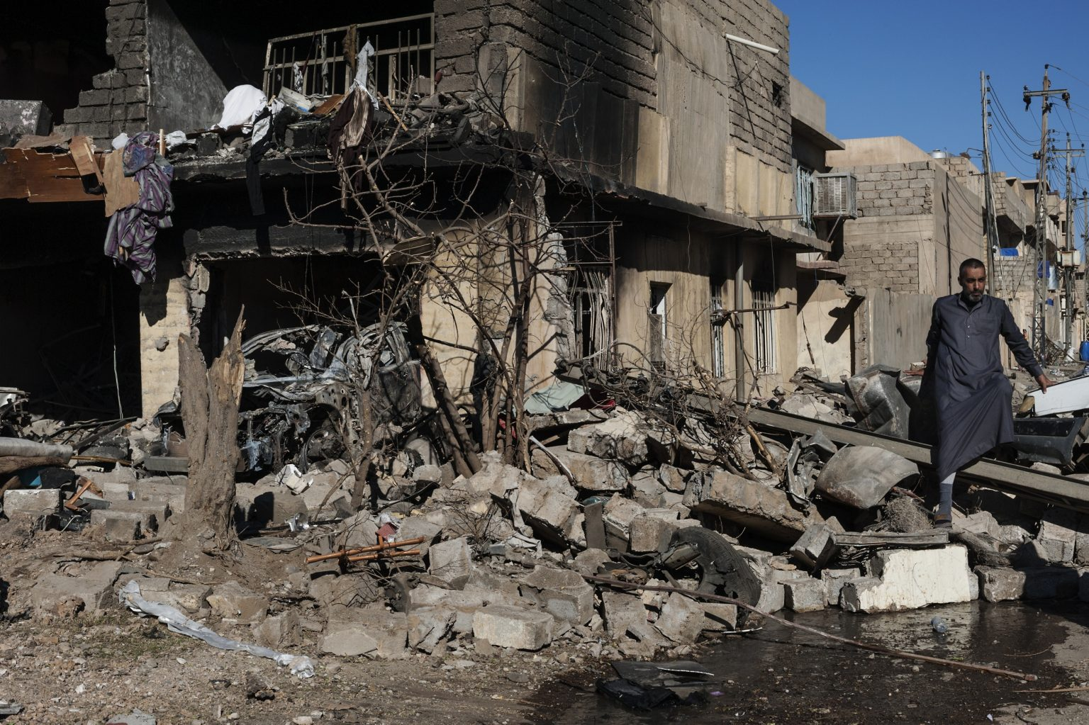 Iraq, Mosul- November 20th 2016 -A man walk near a destroyed building by a car bomb of the so called Islamic State. Ph.Giulio Piscitelli