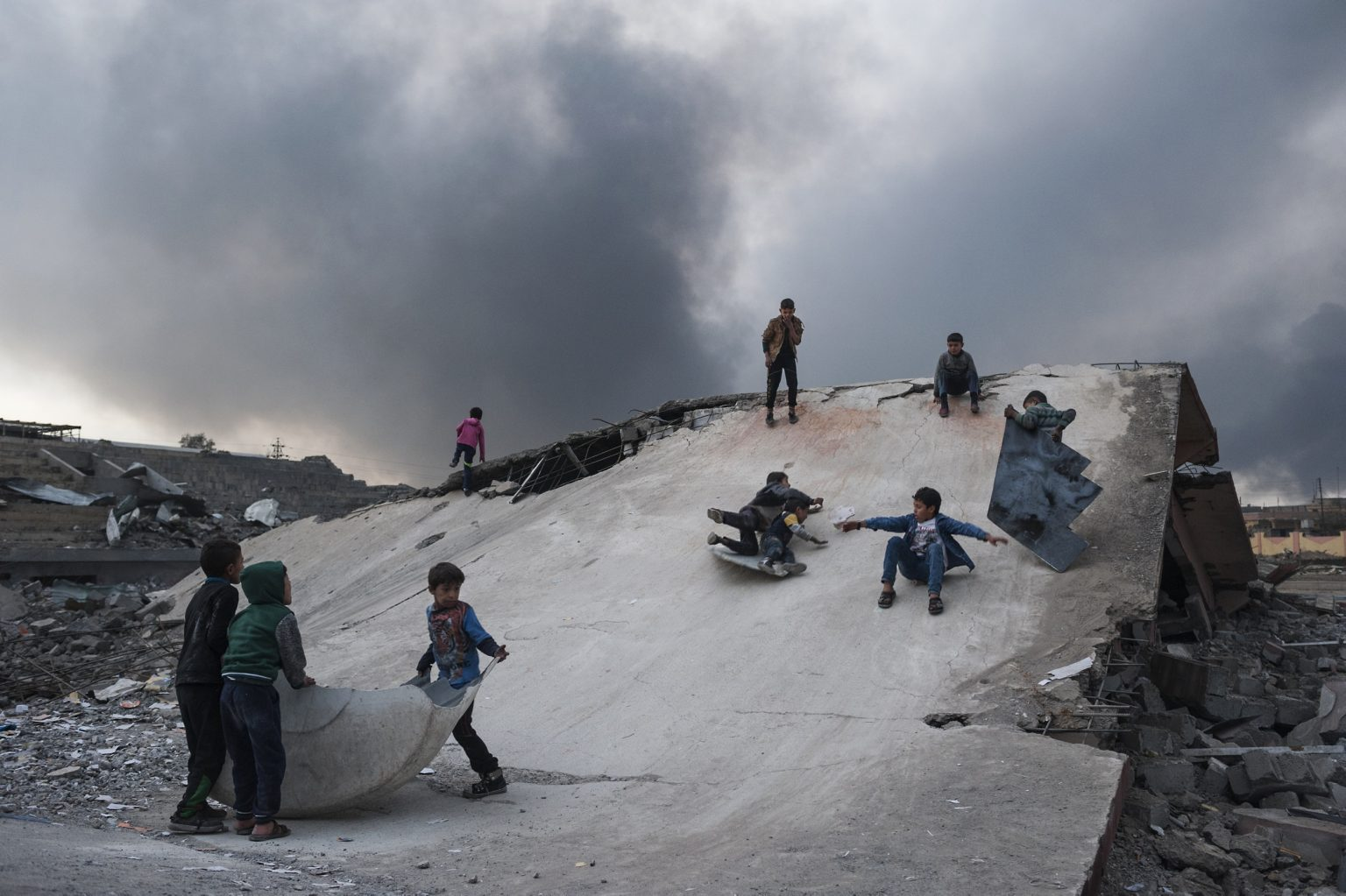 Qayyara, Iraq - November 10th 2016 - Children playing on the rubble of the sport center totally destroyed during the battle between Iraqi forces and Isis.  Ph.Giulio Piscitelli